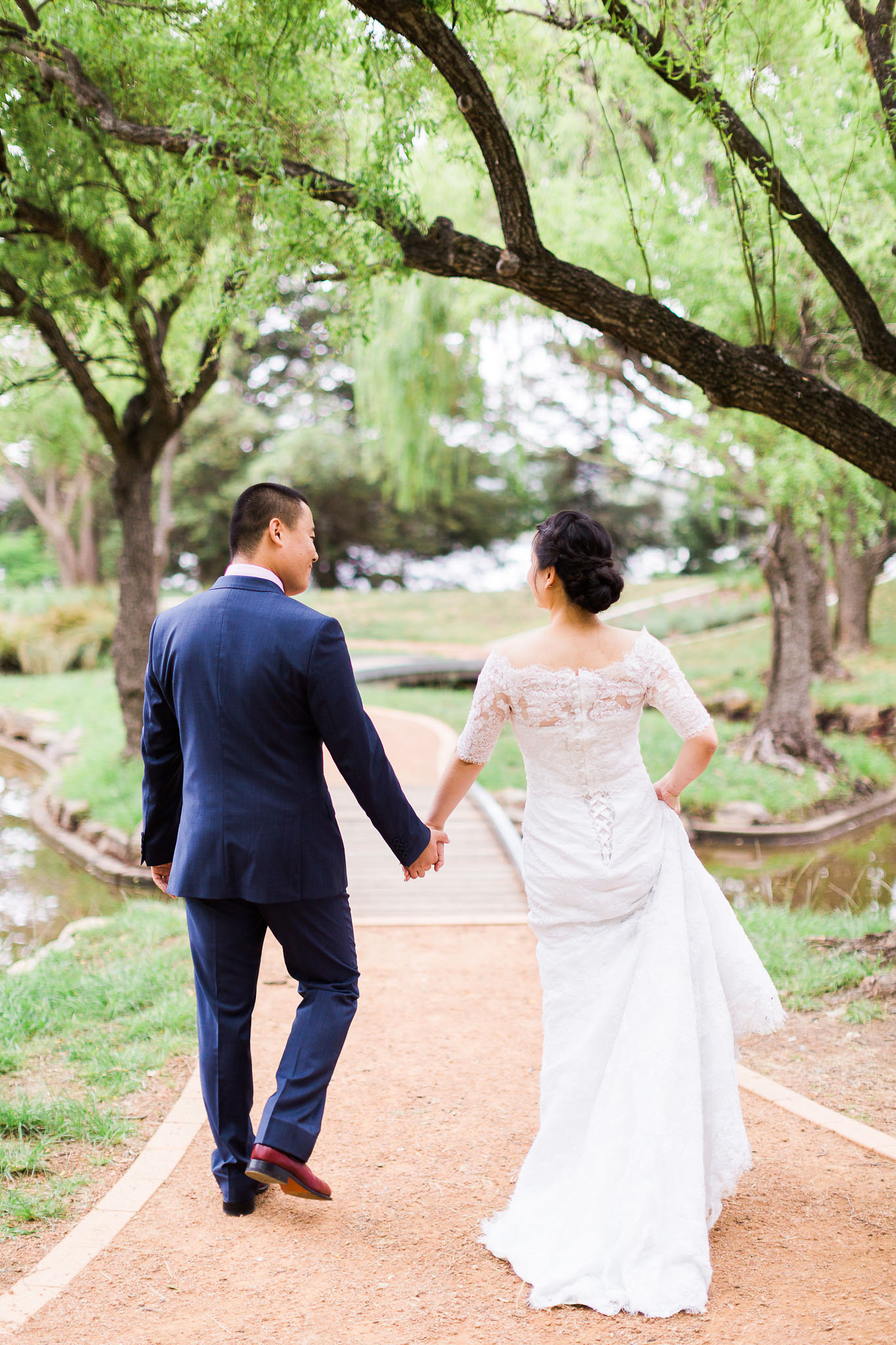 Couple holding hands on their wedding day - Western Park Wedding Canberra