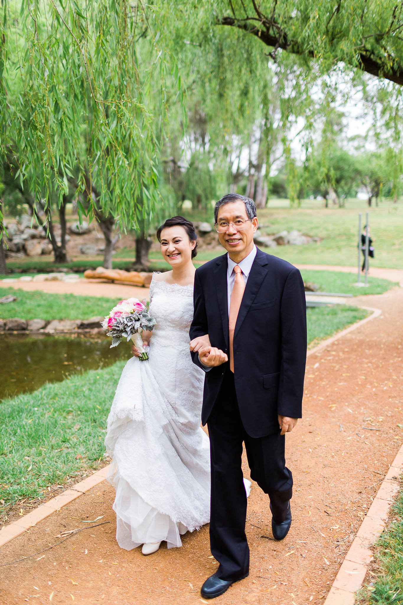 Bride and Father walking down the aisle to be married - Western Park Canberra Wedding Photography