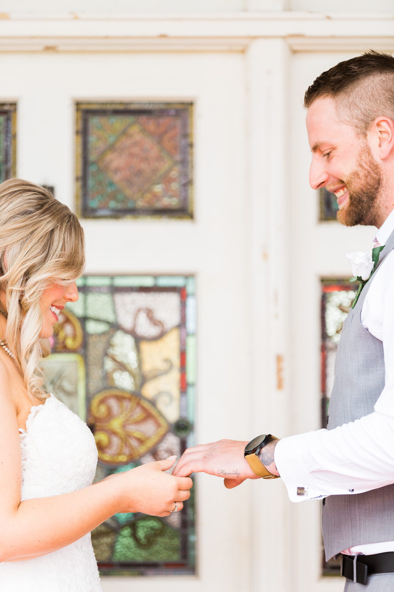 Bride and Groom Exchanging Rings - Gold Creek Station Wedding Ceremony
