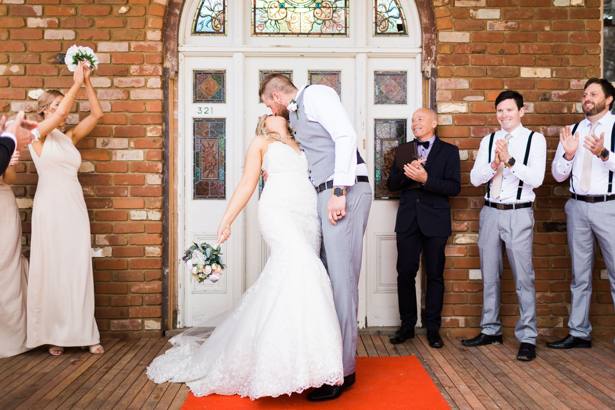 Bride and Groom sharing their first kiss - Gold Creek Station Wedding Photography