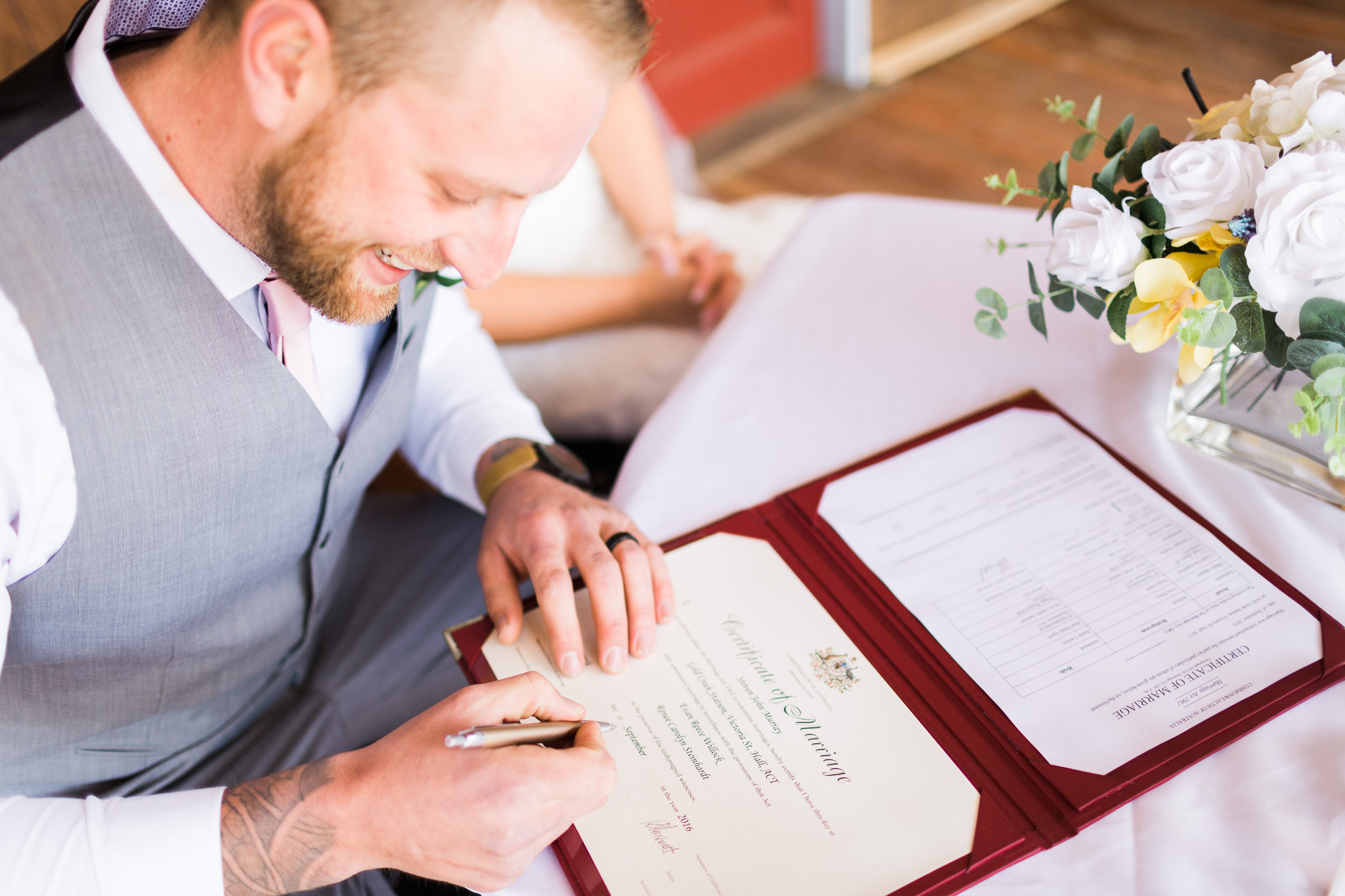 Signing the marriage certificate - Gold Creek Station Wedding