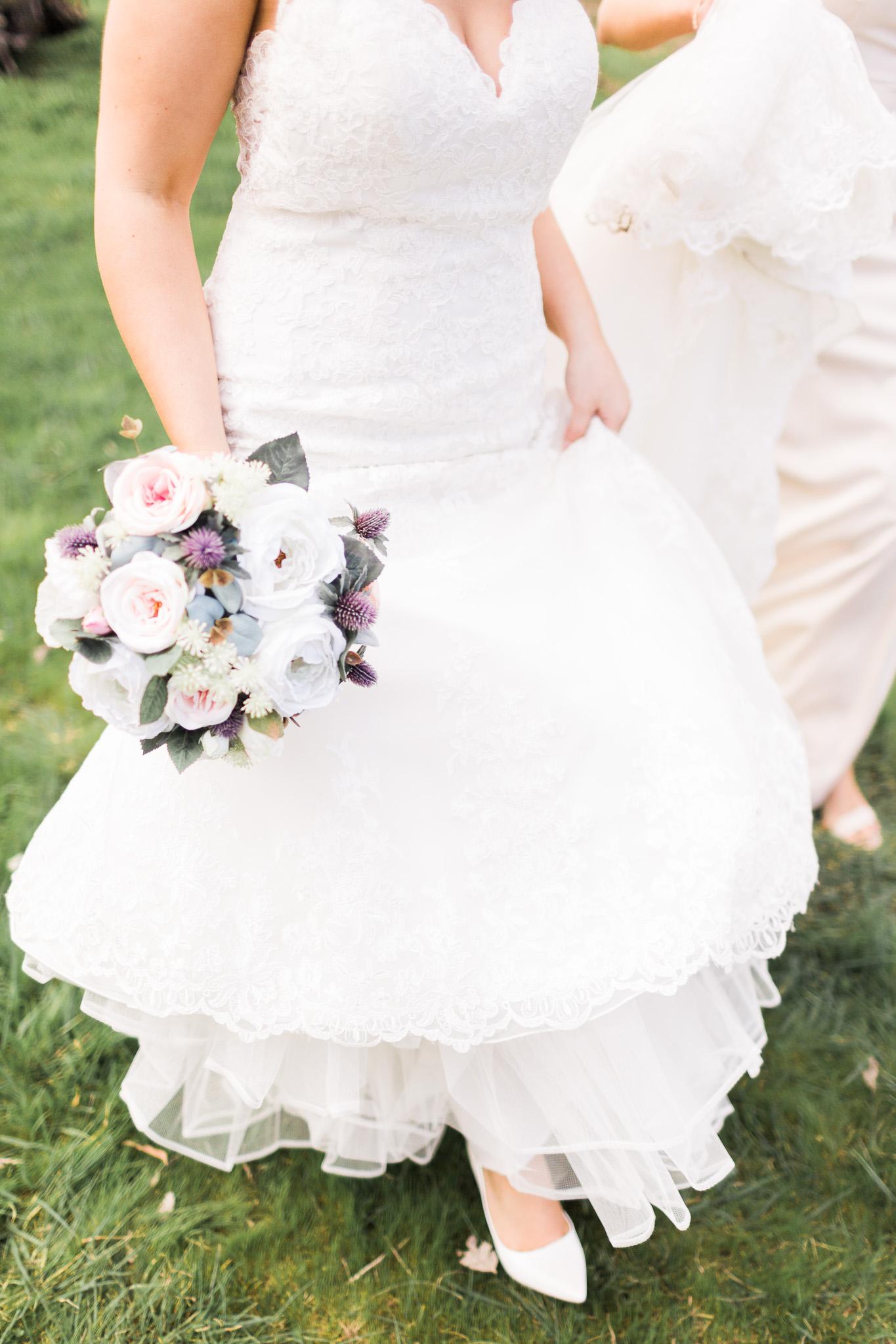 Bride walking in her wedding dress - Gold Creek Station Wedding