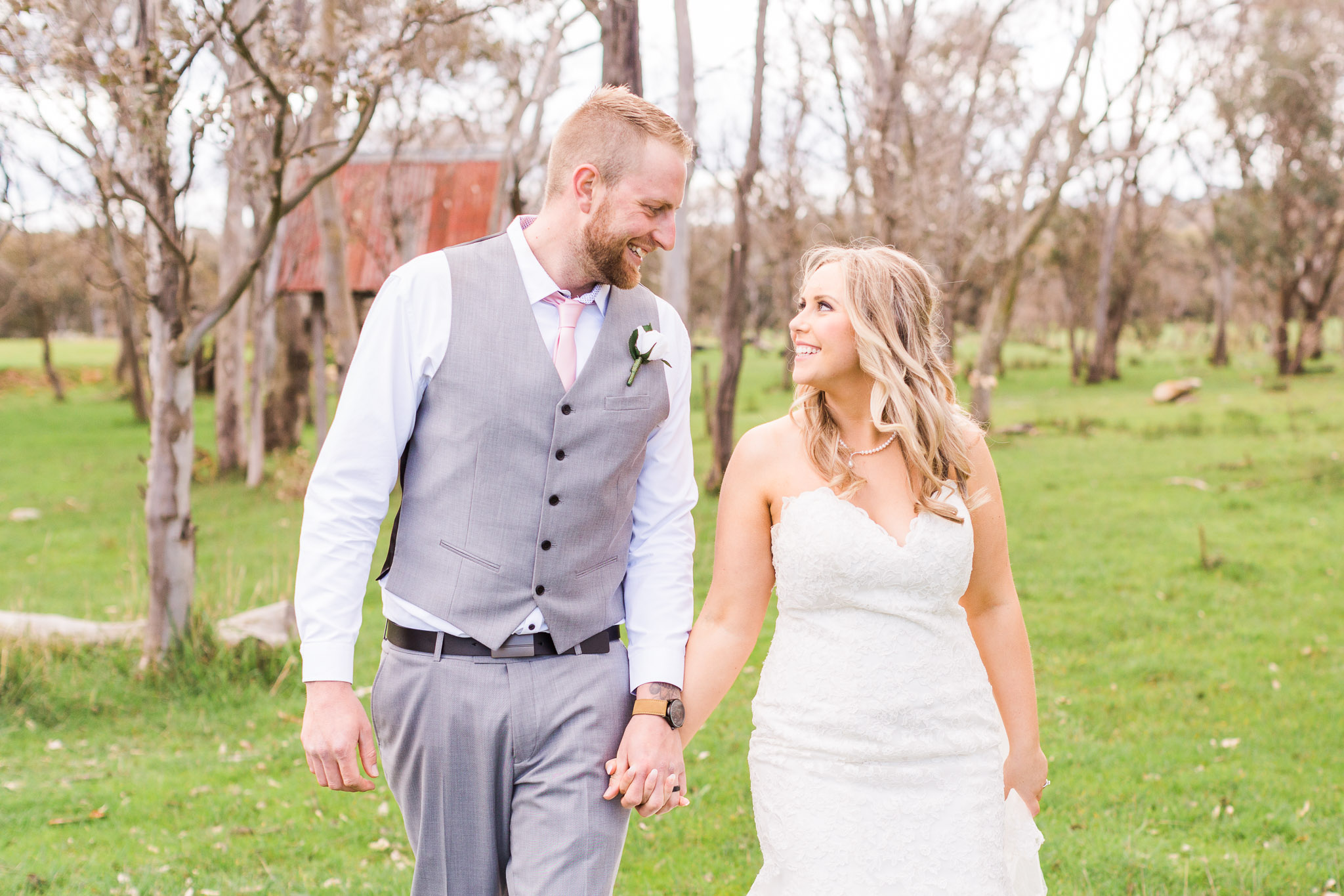 Bride and Groom Holding Hands and Walking - Gold Creek Station Wedding