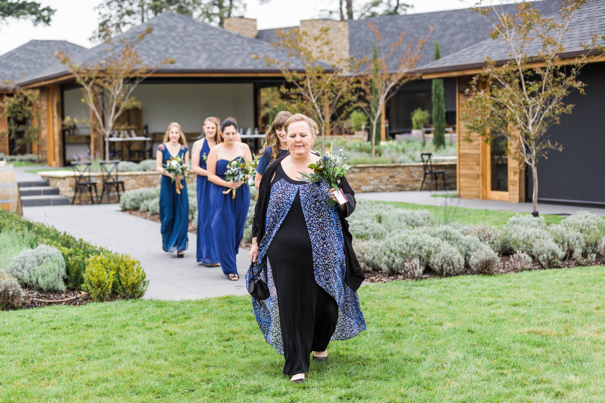 Bridesmaids walking towards ceremony at Pialligo Estate Wedding