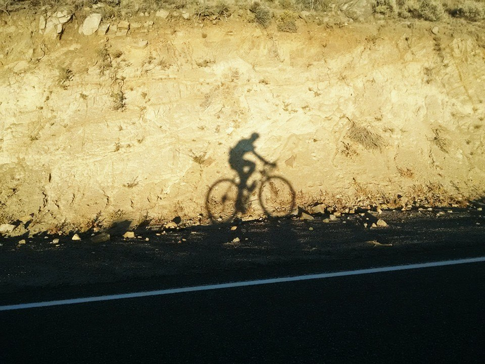Brandon's shadow cast onto the mountainside of Austin Summit as he begins his first long stage of the race. Photo by: Brandon Tinianov.
