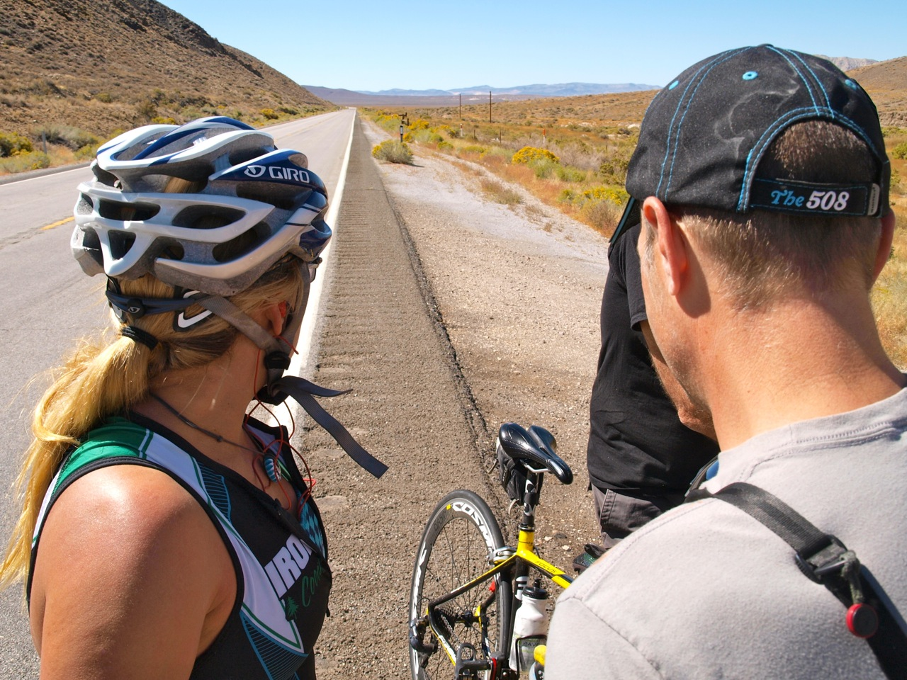 At the old Pony Express stop, I gather water and advice from my team. Here, Brandon and I look not he miles we've ridden so far and there's not another team in sight. Photo by: Chris Kostman.