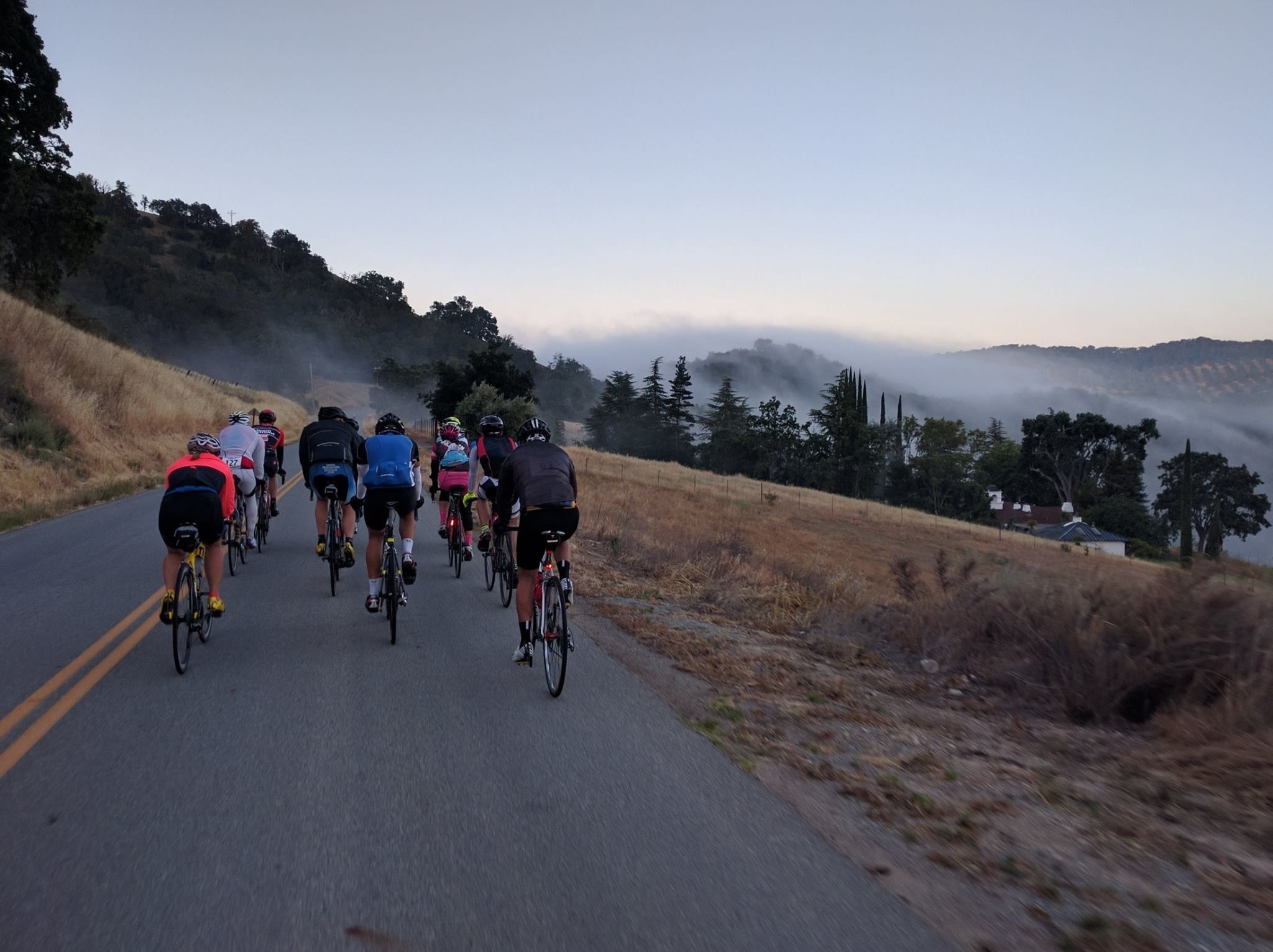 Riding up the first climbs, we watch the fog burn off the hilltops.