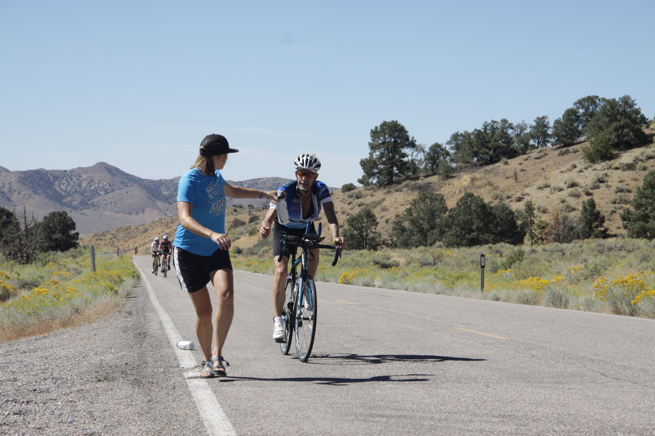 Jami Horner hands water and necessary nutrition to Fritz F. on his 112-mile stage through the tough part of the Great Basin.