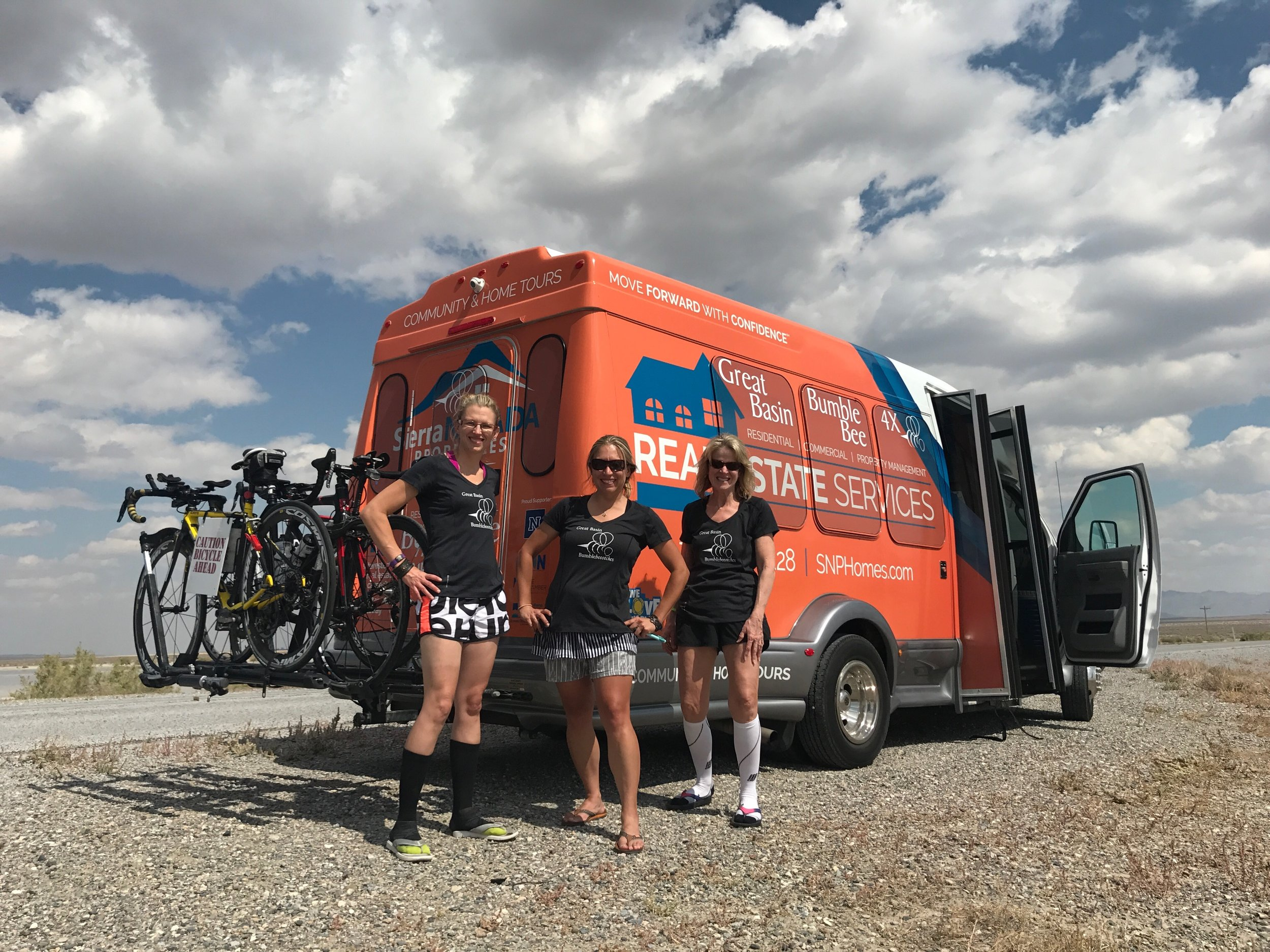 Team shot with the orange bus graciously donated by Sierra Nevada Properties. Katie (not pictured) is riding the 106-mile third stage of the race. Left to right: Rhonda Y., Rebecca E. and crew Linda.