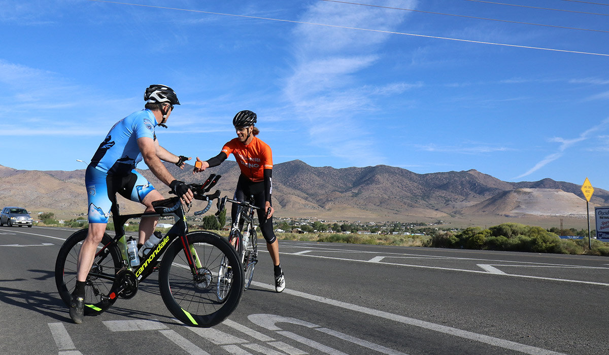 Mike hands off the GPS tracker to Rich after his amazing performance up Geiger Grade, through Virginia City and down Six-Mile Canyon. Rich would ride another 60 miles to a spot near Nevada's infamous Sand Mountain.