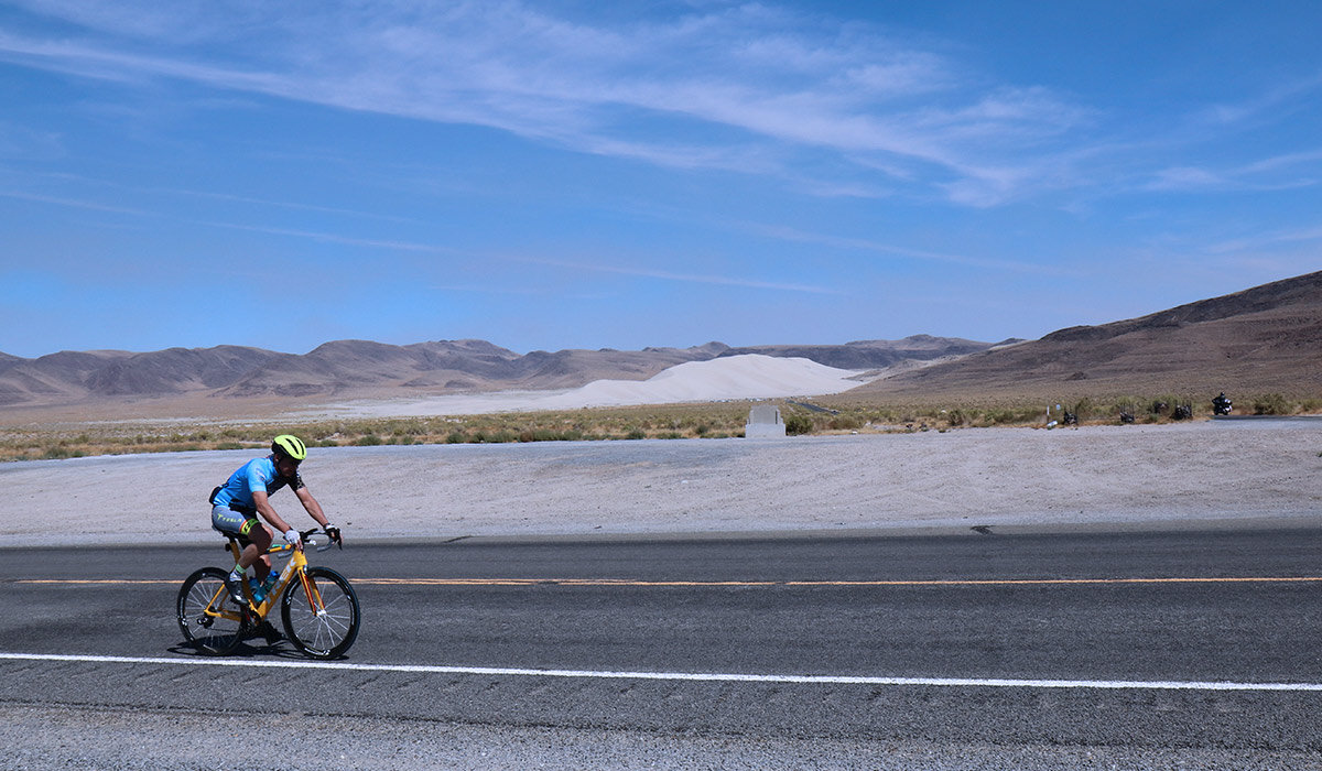 In his first mile of his first leg of the race, Kevin rides by Sand Mountain, an iconic landmark. The mountain changes shape every day due to the circular wind patterns in the valley (which are also the reason the mountain of sand is there in the first place.) It's most commonly used by four-wheelers and other ATV fans who camp at the base of the mountain and spend their days climbing up its varied terrain. Legend has it that a Wells Fargo wagon loaded with gold was passing through the valley back in the late 19th century, and parked near Sand Mountain at night. When whoever was driving the wagon woke the next morning, it was gone; the wind and sand had engulfed the wagon and all that was inside. No one's ever found any trace of it, and the legend continues to this day.