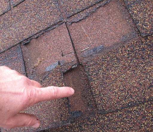 cracked shingles signs of roof damage.jpg