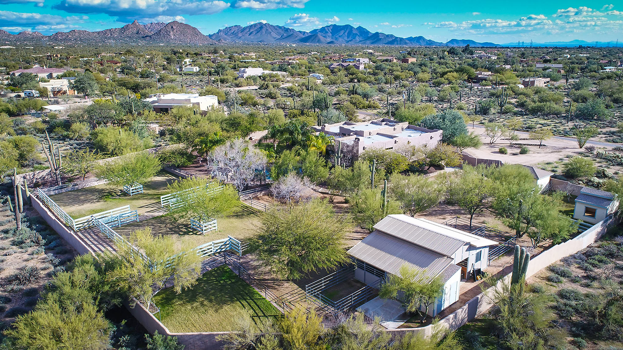 Overview of enclosed lush residential home and horse facility in North Scottsdale.