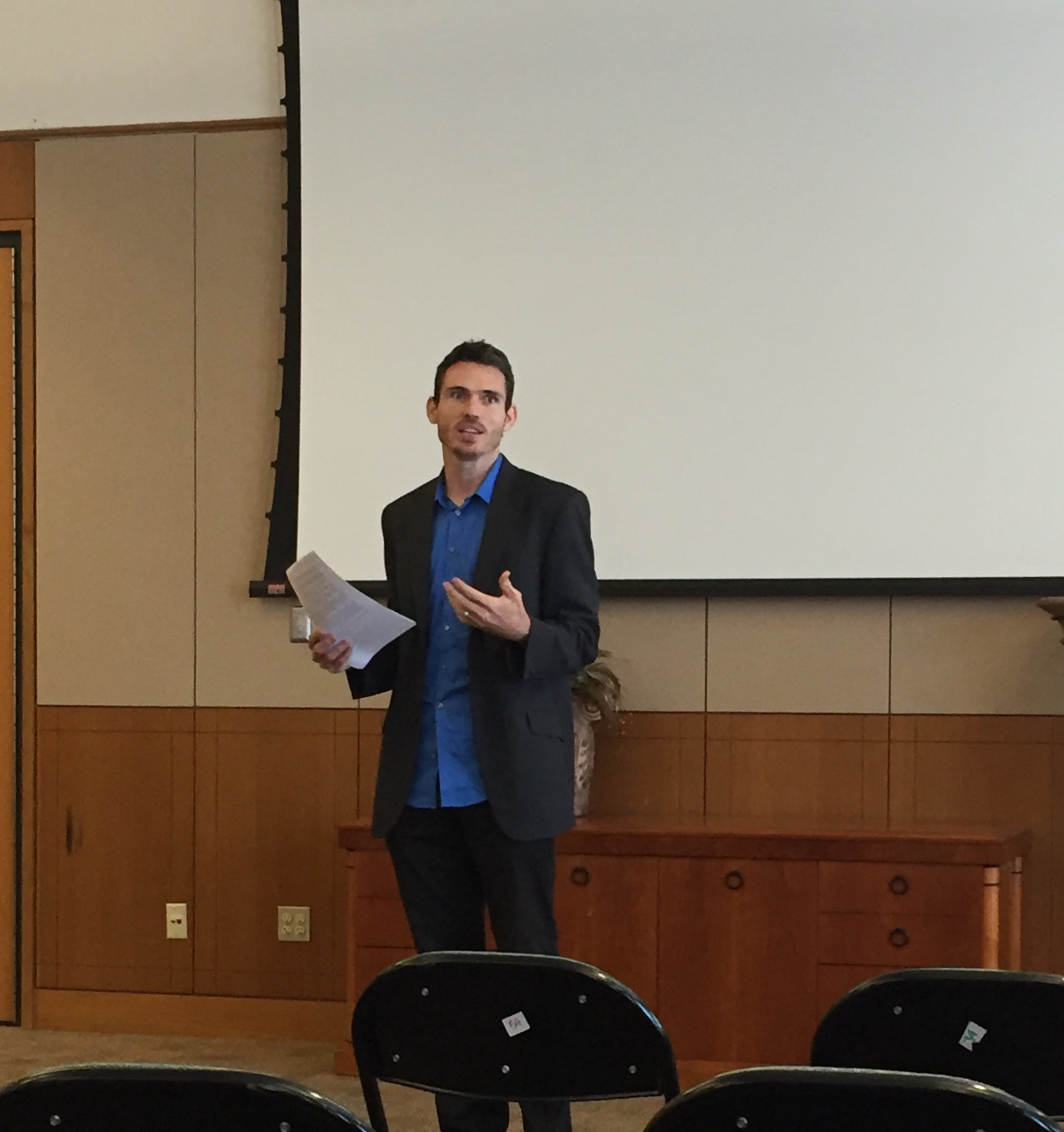 "Josh Rasmussen delivering his paper, ""Universalist Worlds."""