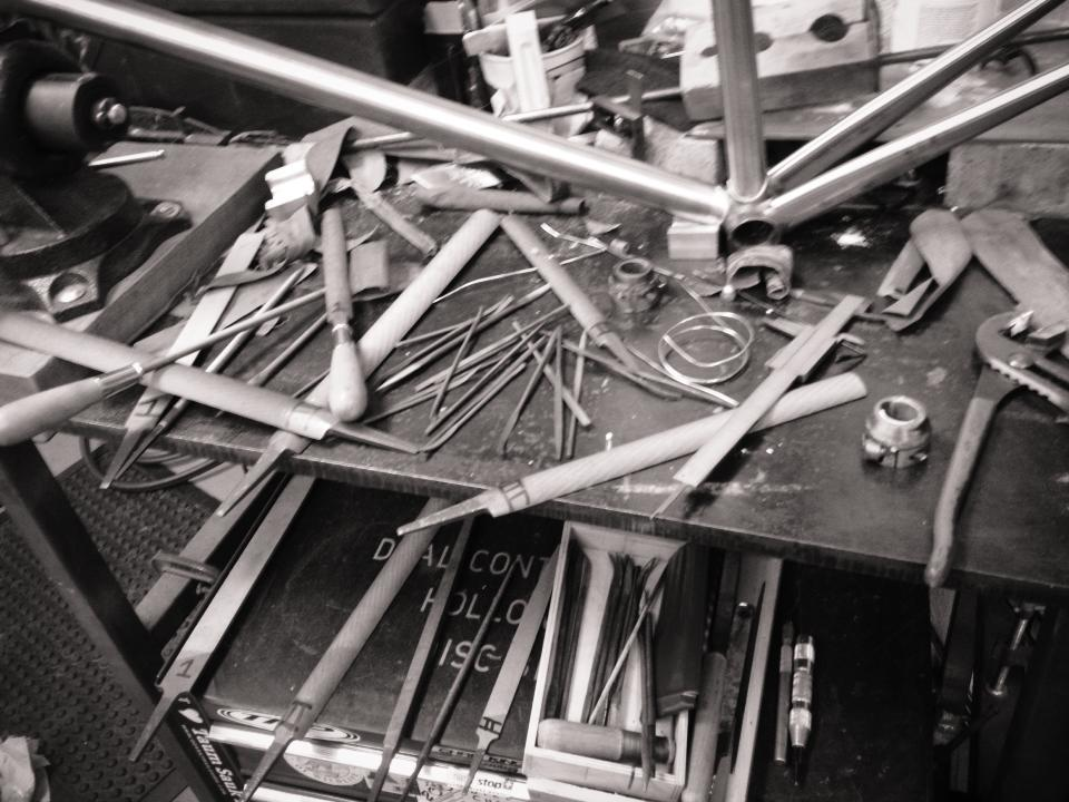 metal files behind a LaBerta custom steel frame