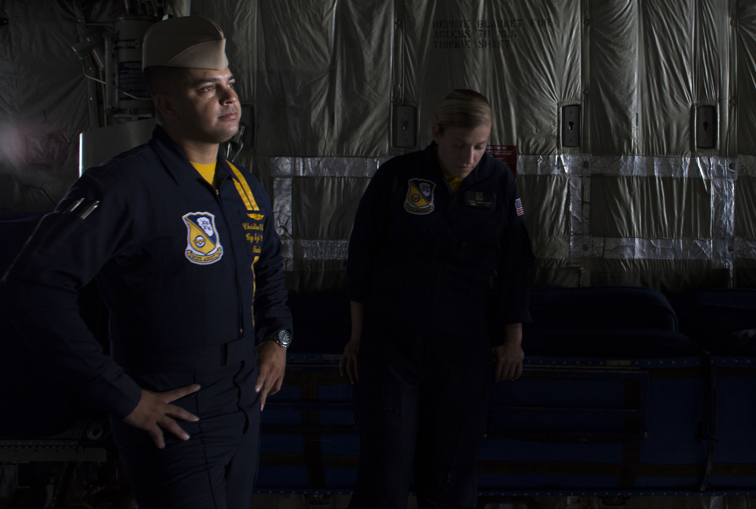 Gunnery Sgt. Chris Villalobos and Mass Communication Specialist Katy Macdonald stand in the back of the Blue Angels' Fat Albert aircraft while waiting for a debriefing after a short flight at the Arnold Palmer Regional Airport.