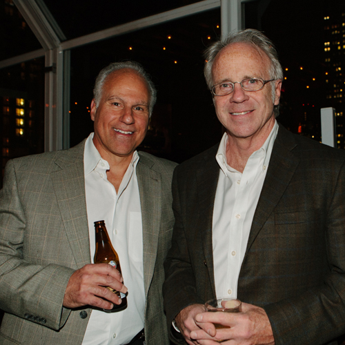 John Athorn (left) and George Clark (right) celebrating AC&P's 15th anniversary on the rooftop of the Strand Hotel.
