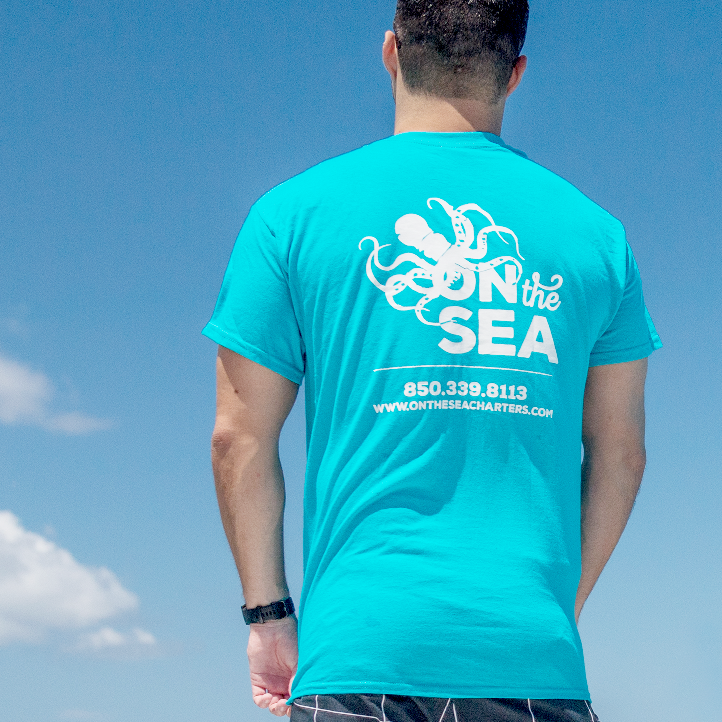 on-the-sea-charters-two-thumbs-motorboating-tee-2.png