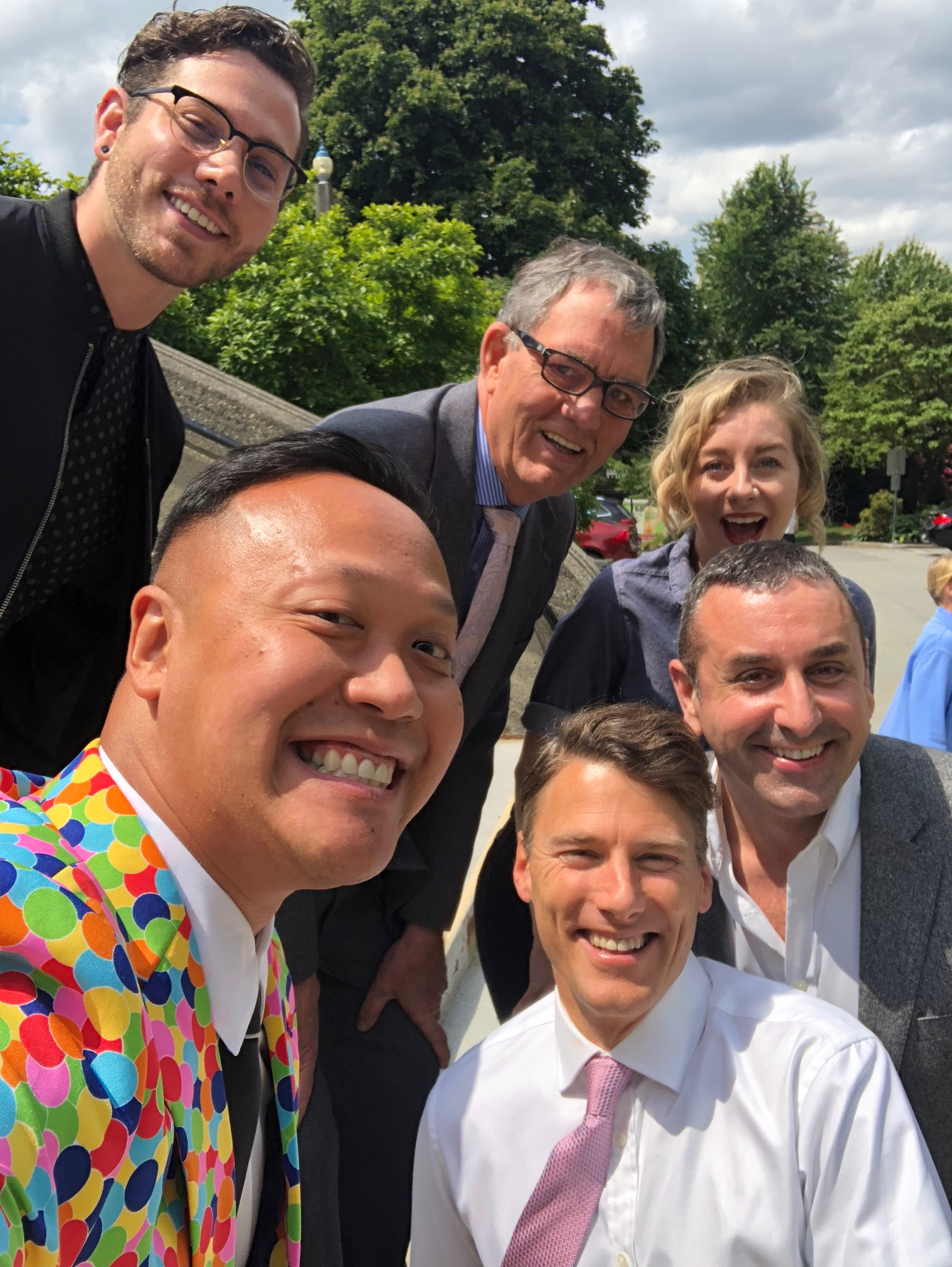 Peter celebrating the historic win with Vancouver Mayor Gregor Robertson, bottom right, and Vancouver City Councilman Tim Stevenson, top center, and three members of the LGTBQ2+ Committee, which — with Peter's help — drafted the ban.