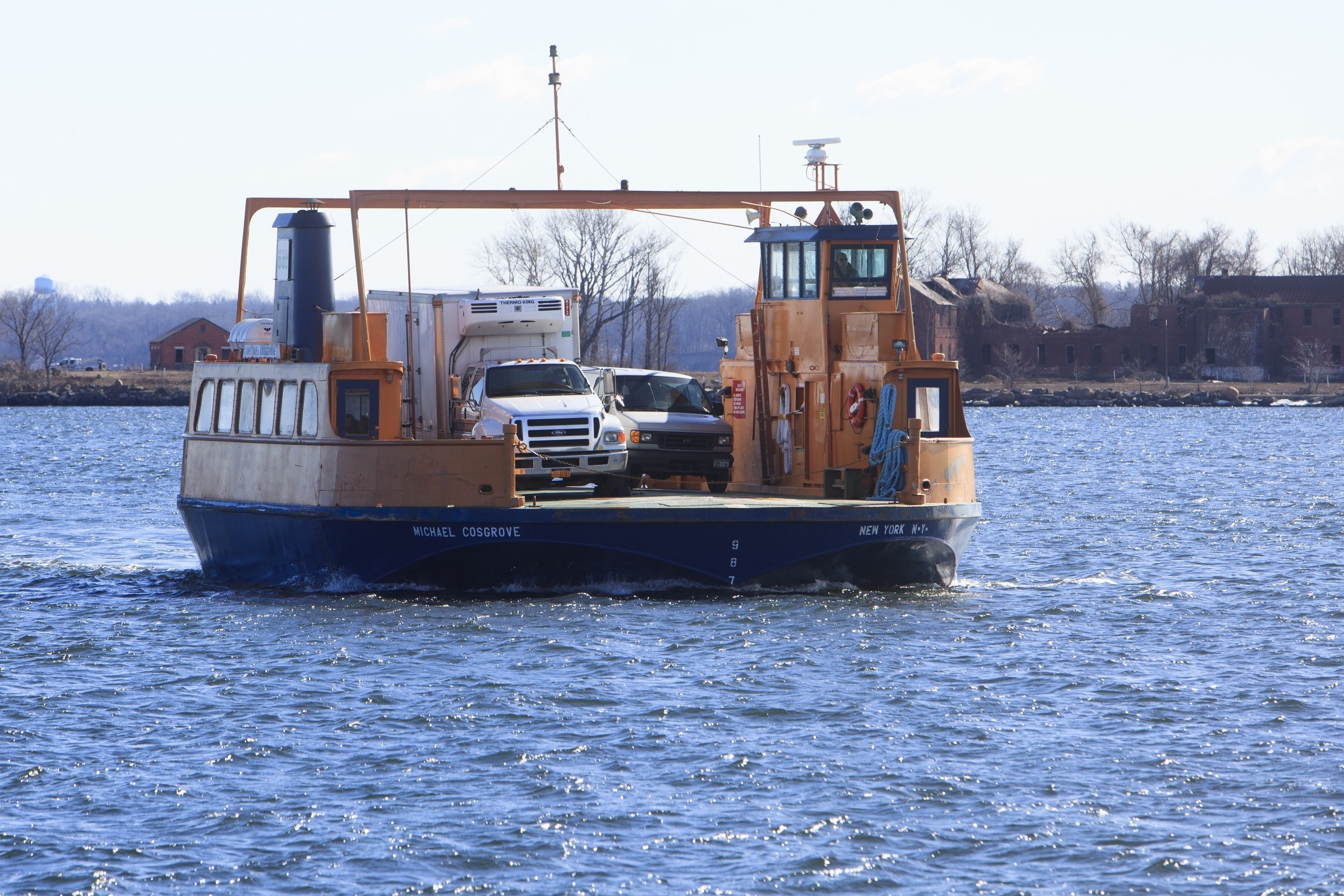 A medical examiner's truck returning from Hart Island after having brought bodies for burial.