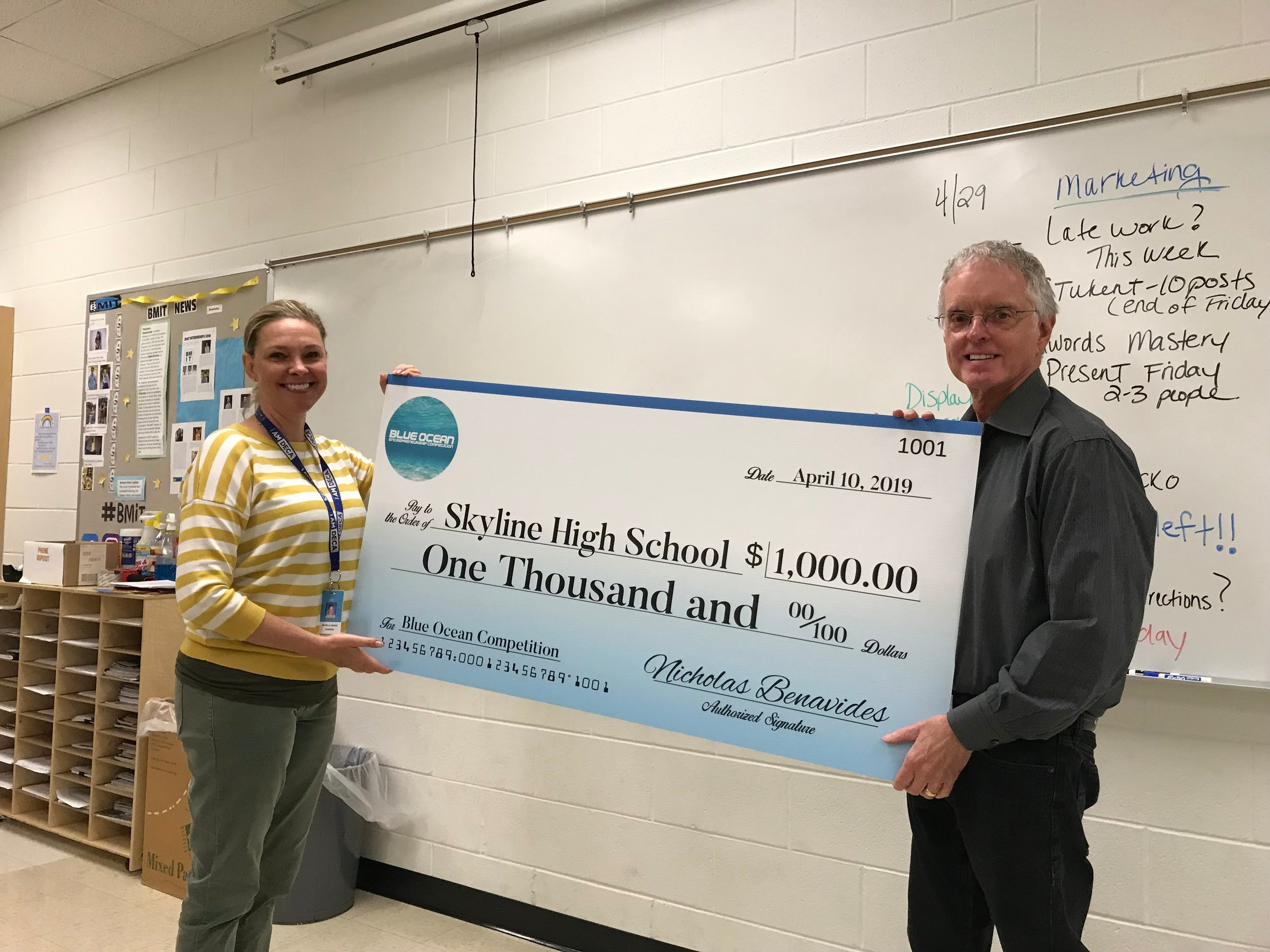 Skyline High School - Click on the image to see press coverage of Skyline High School's winning an award from the Blue Ocean Student Entrepreneur Pitch Competition.Ted Dacko, Executive Director, presenting the check to Michelle Wargo of Skyline High School Ann Arbor, Michigan