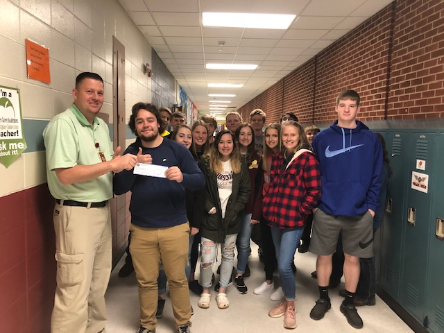 Pillager High School - Bryan Pederson and his students with the $1,000 check from the Blue Ocean Student Entrepreneur Pitch Competition. Click the image to read the interview with Bryan.Pillager, Minnesota
