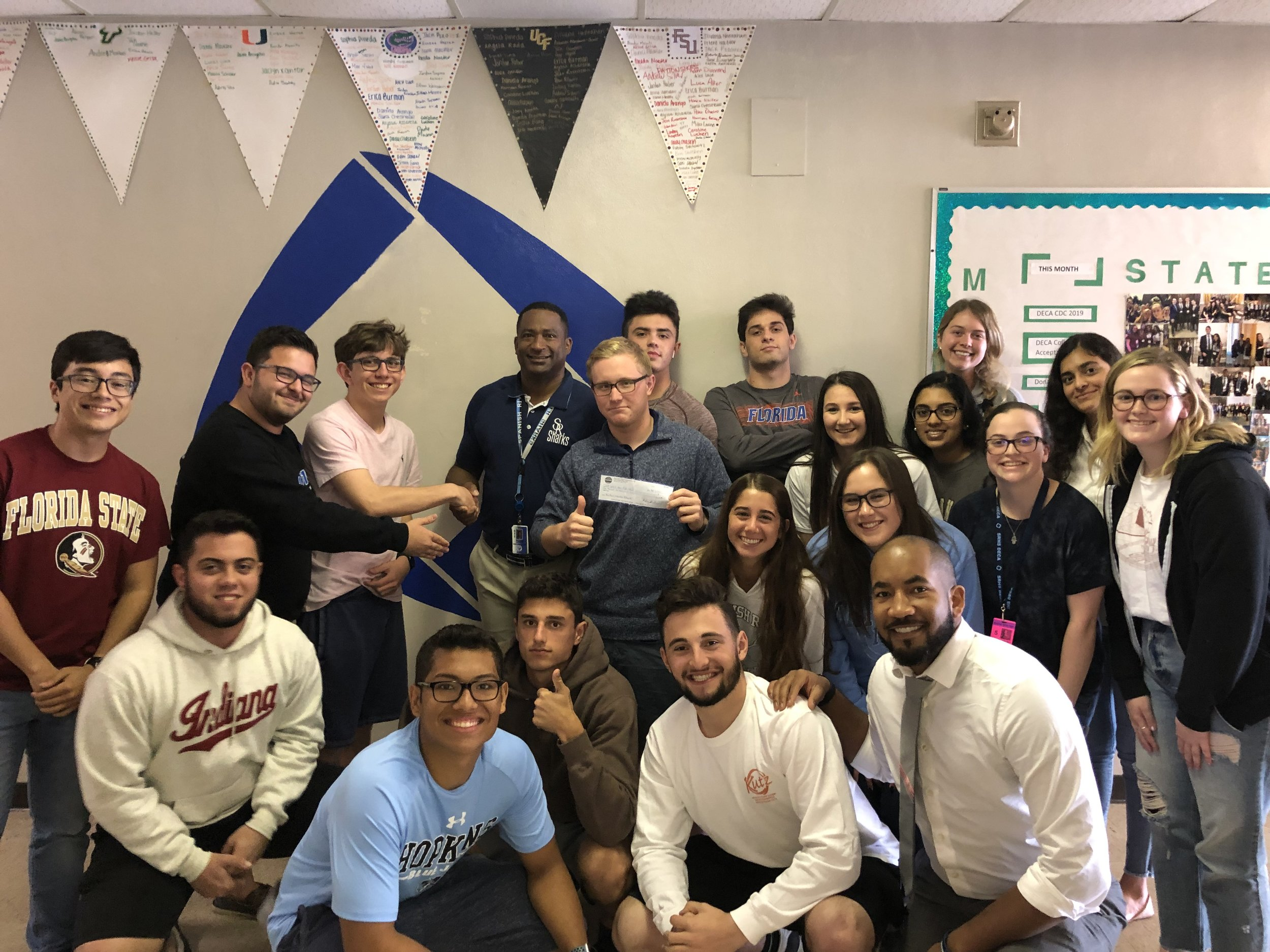 Spanish River High School - Alain Bazile and his students wit the $1,000 check from the Blue Ocean Student Entrepreneur Pitch Competition. Click the image to read the interview with AlainBoca Raton, Florida