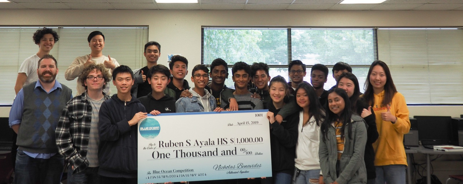 Students at Ruben S. Ayala High School in Chino Hills, CA receiving their $1k prize check with Computer Science Teacher Derek Arnell.