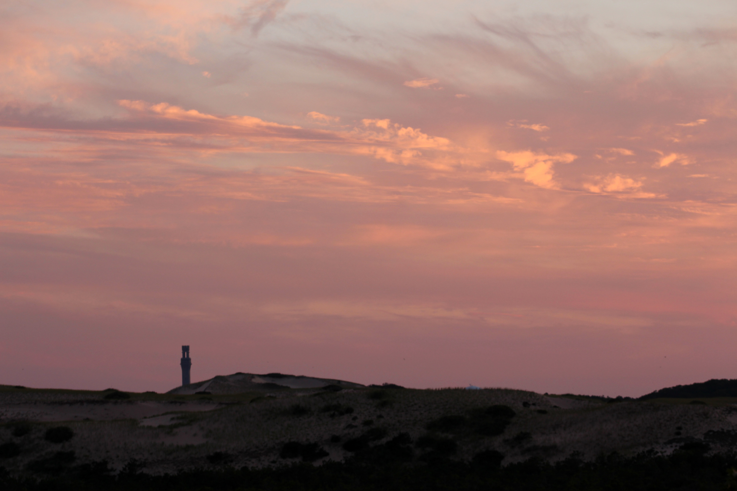 The Pilgrim Monument on the horizon is one of the few reminders of town and life outside the dunes.