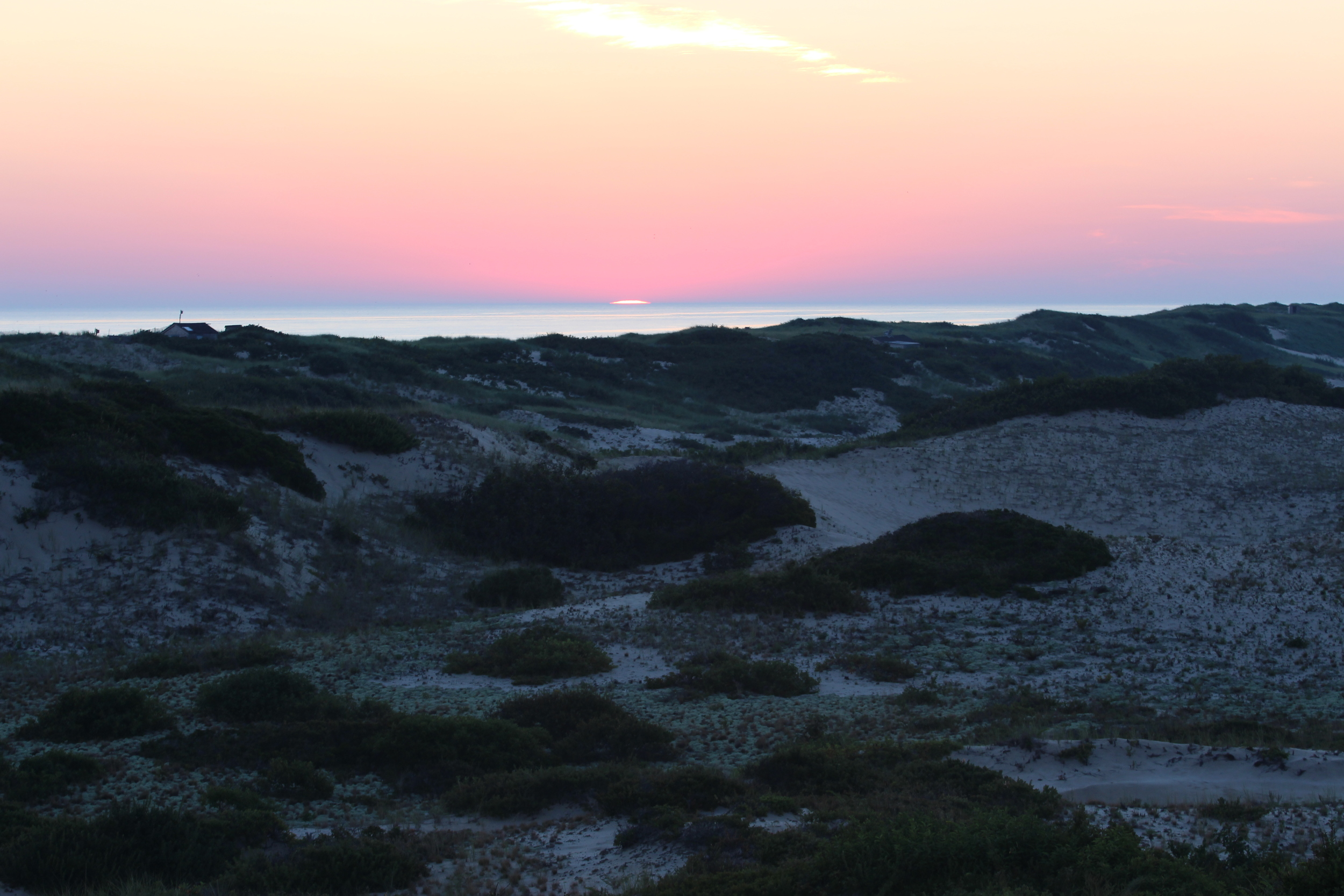 the dark dunes just before illumination
