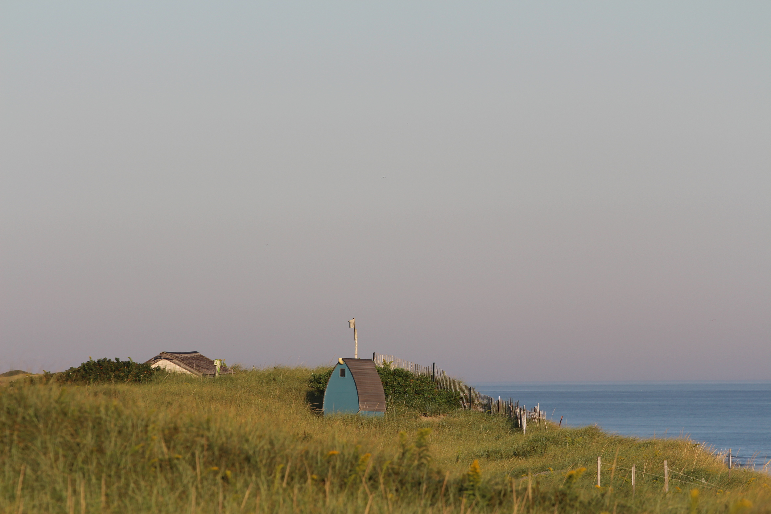 Other shacks appear like this, peaking over the dune grass.  They remind me of Smurf Houses.