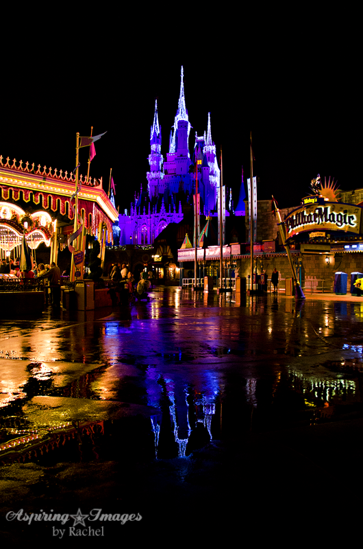 Magic Kingdom Carousel, Castle, and Philharmagic at Night in Rain by Aspiring Images by Rachel