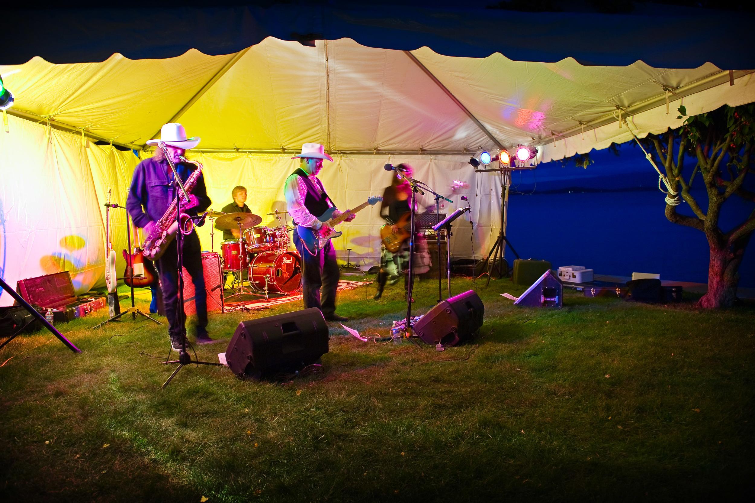 A live band at a wedding on Flathead Lake, Montana plays. -Kelsey Lane Photography