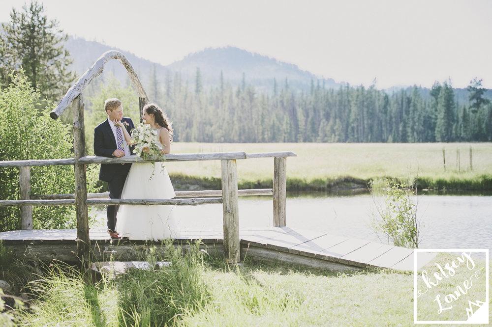 Rustic+Montana+Wedding_Grey+Wolf+Ranch_Kelsey+Lane+Photography_Bride+and+Groom+Bridge.jpg
