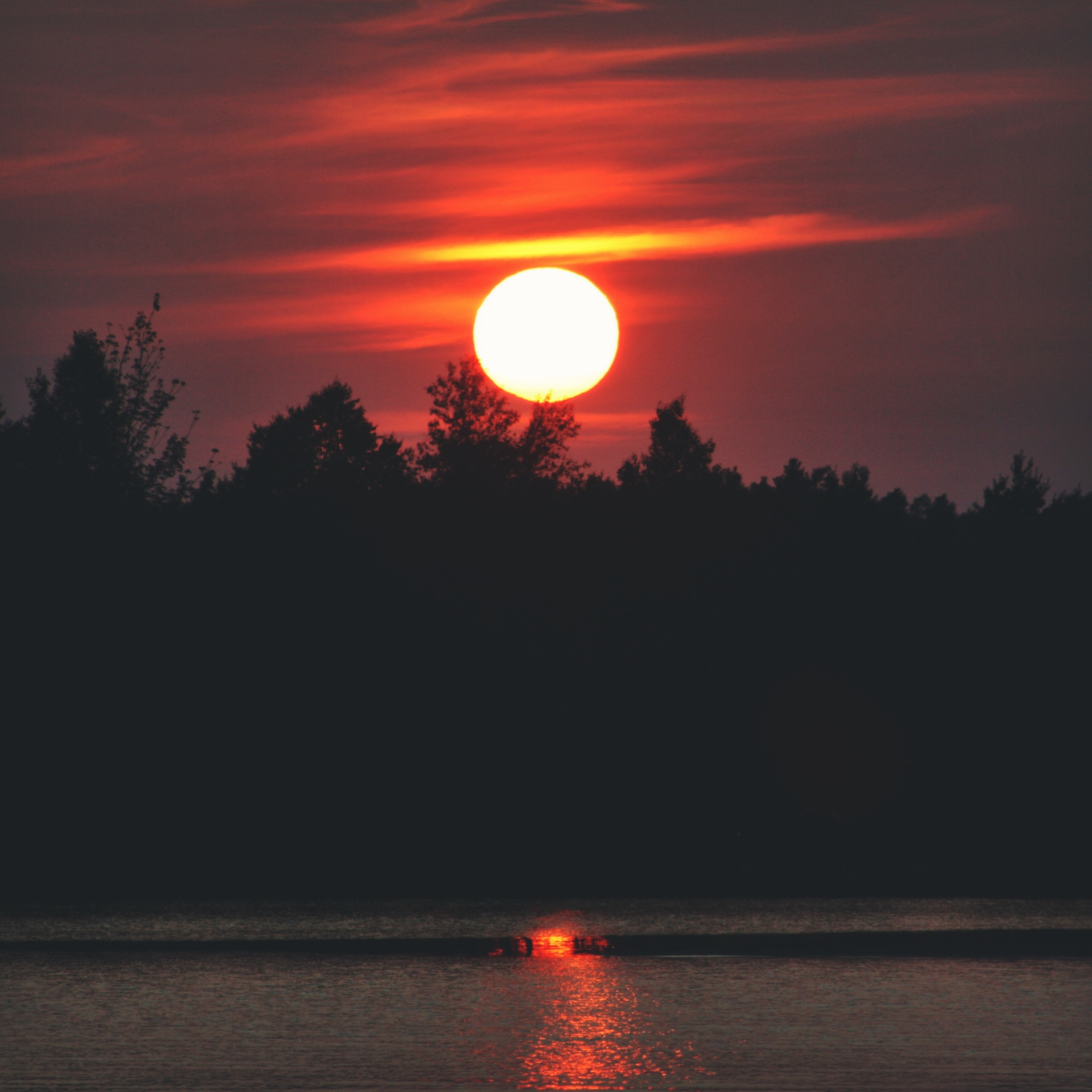 An abnormally beautiful sunset due to the Canadian wildfires happening in the region.