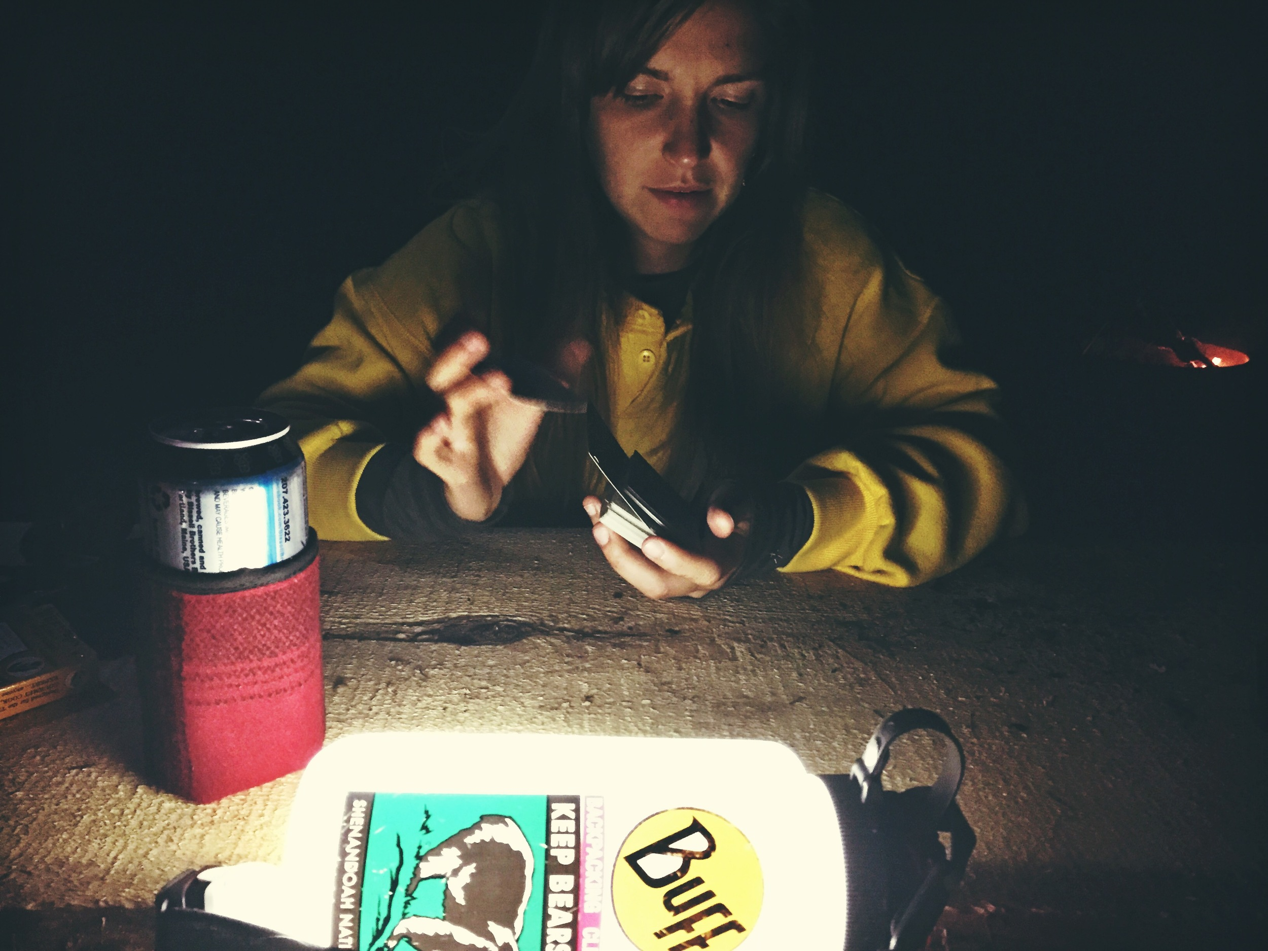 Playing cards by the light of our headlamps.
