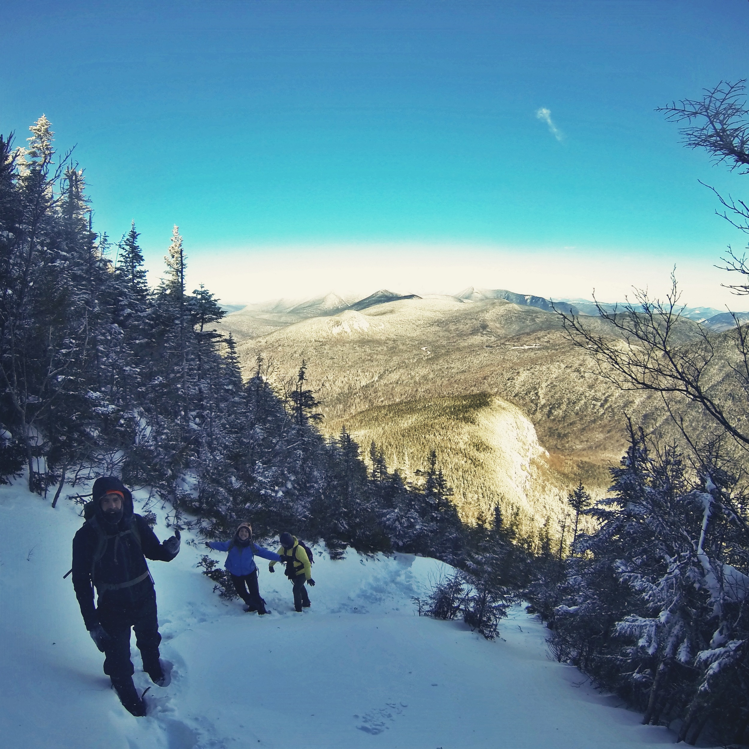 The gang heads up the exposed slope, views of the Sandwich Range.