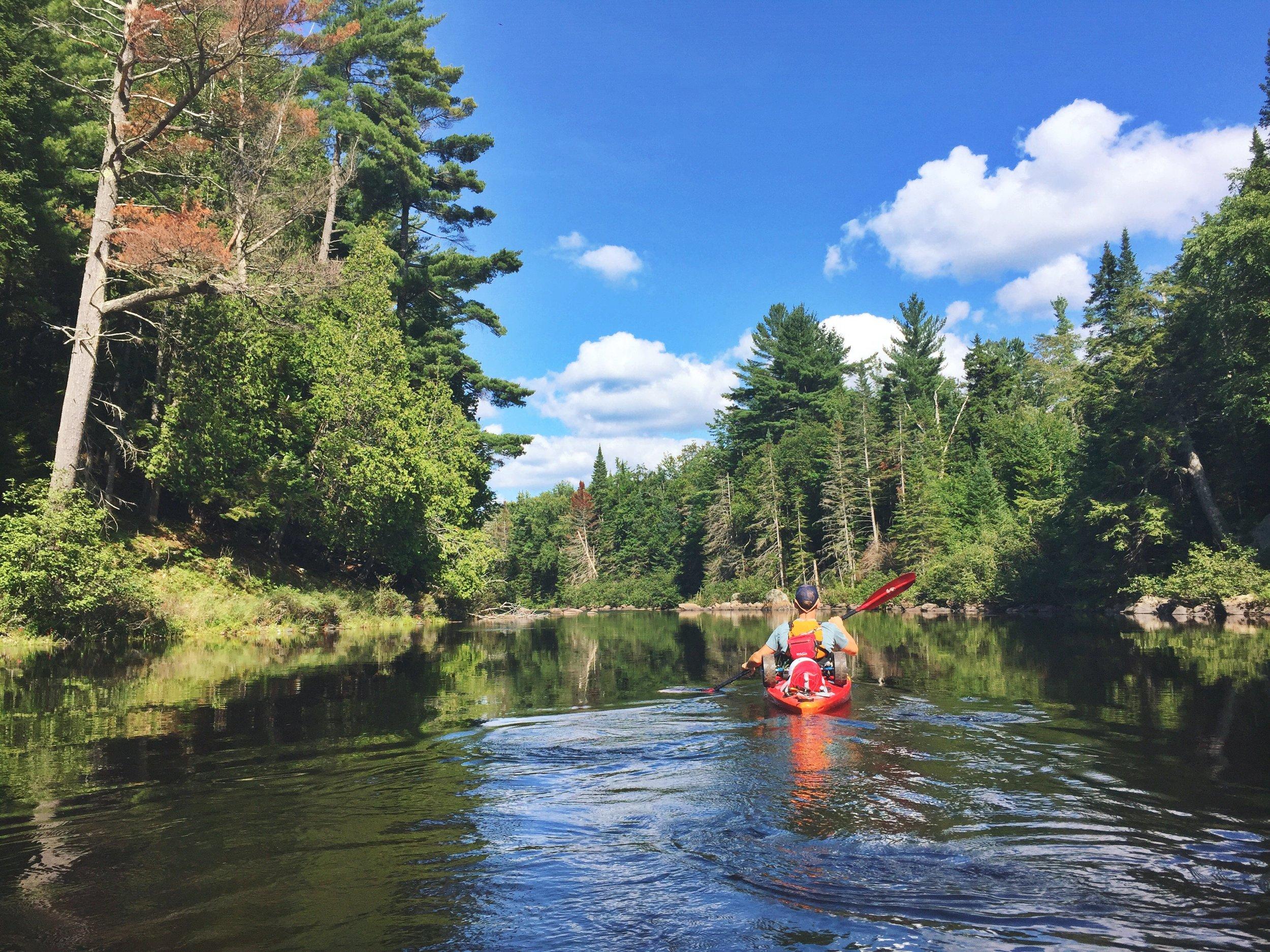 Teton paddles down the beautiful Raquette River.