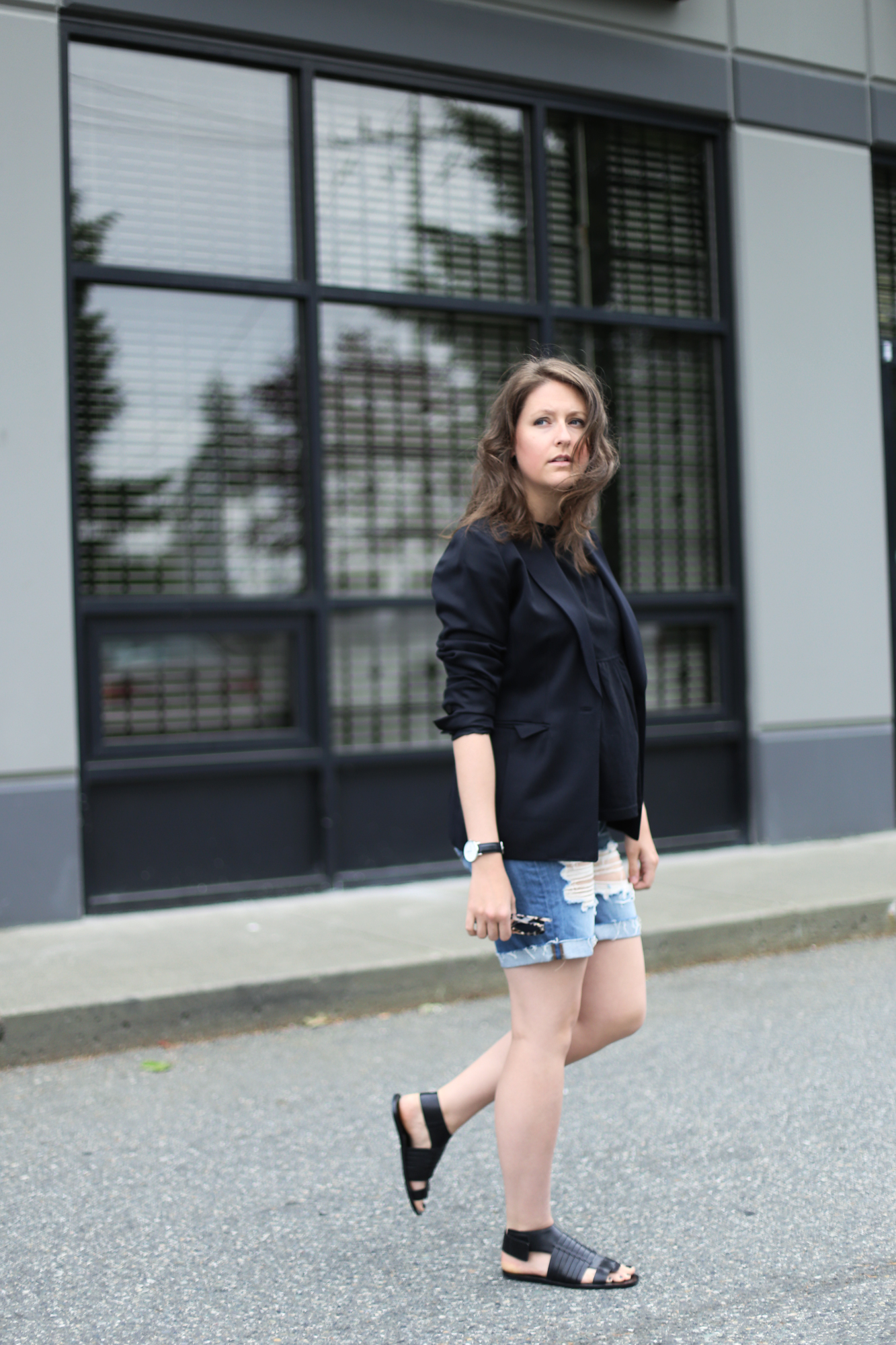 Minimalist street style outfit: Vince sandals, Daniel wellington watch, j brand ripped shorts, and a $15 top.