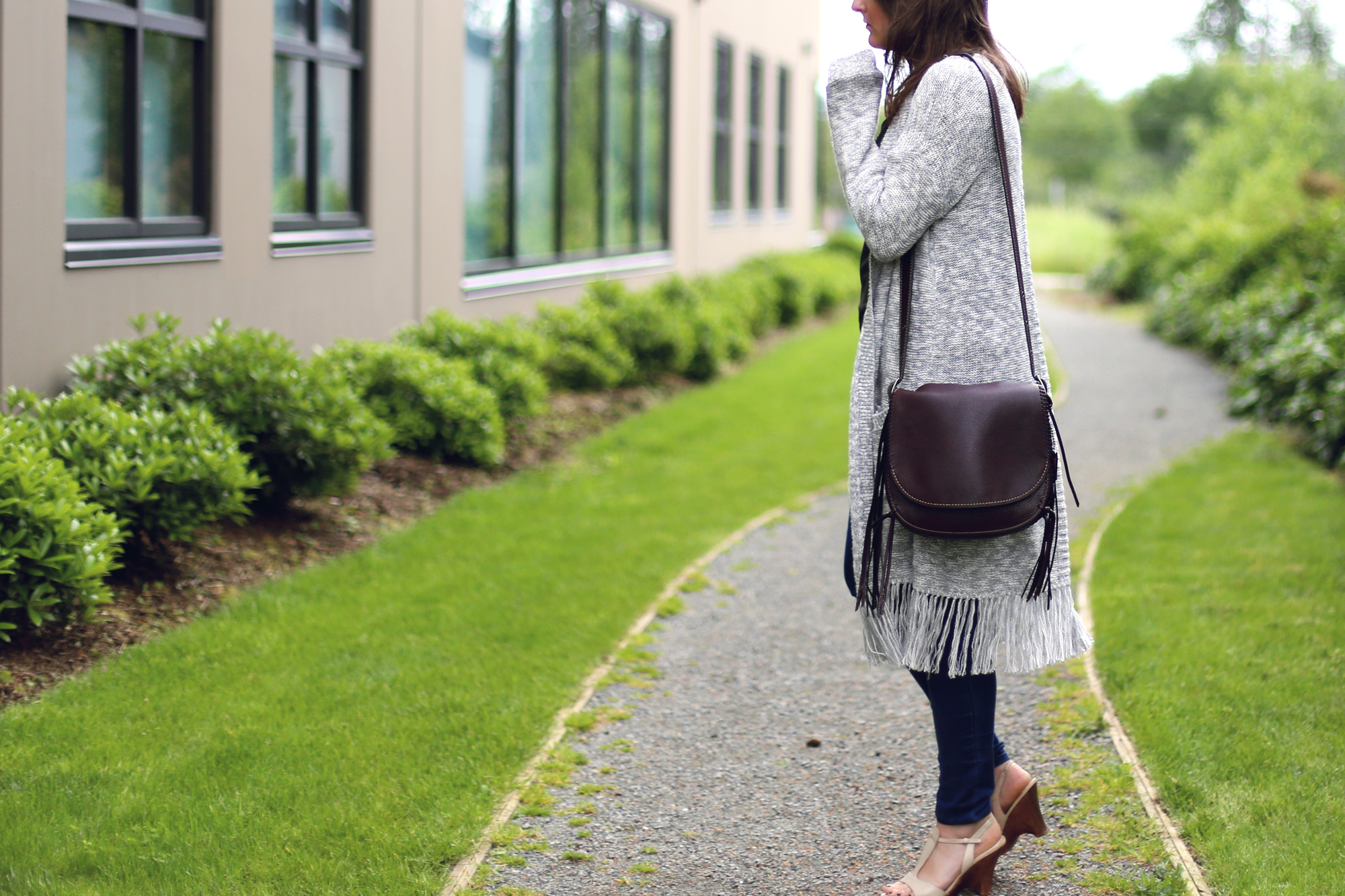 All tassel outfit: grey oversized tassel sweater and a leather tassel purse. #ootd