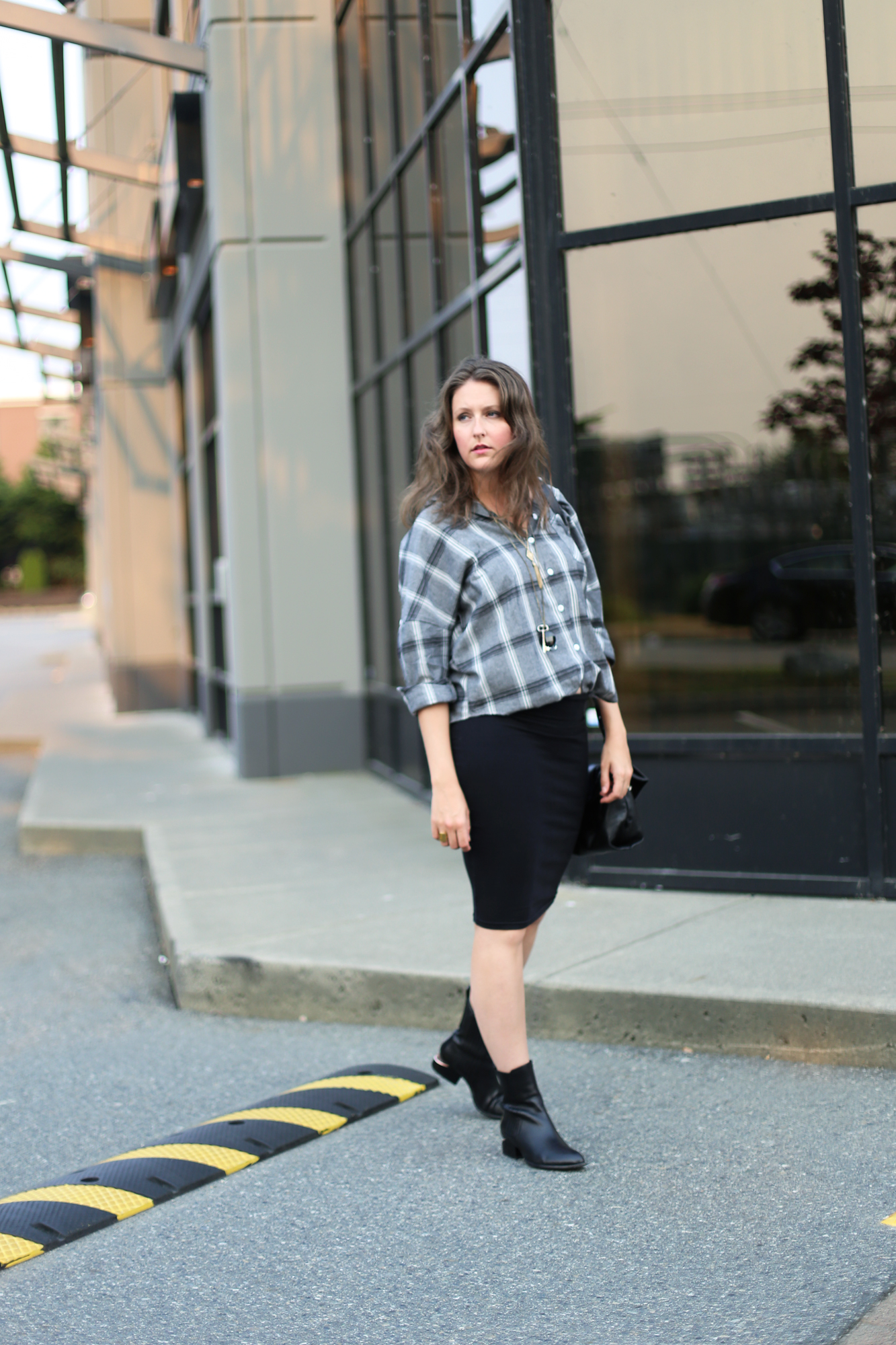 Love this classic minimalist outfit: alexander wang anouck boots, black tube skirt, and an oversized boyfriend shirt.