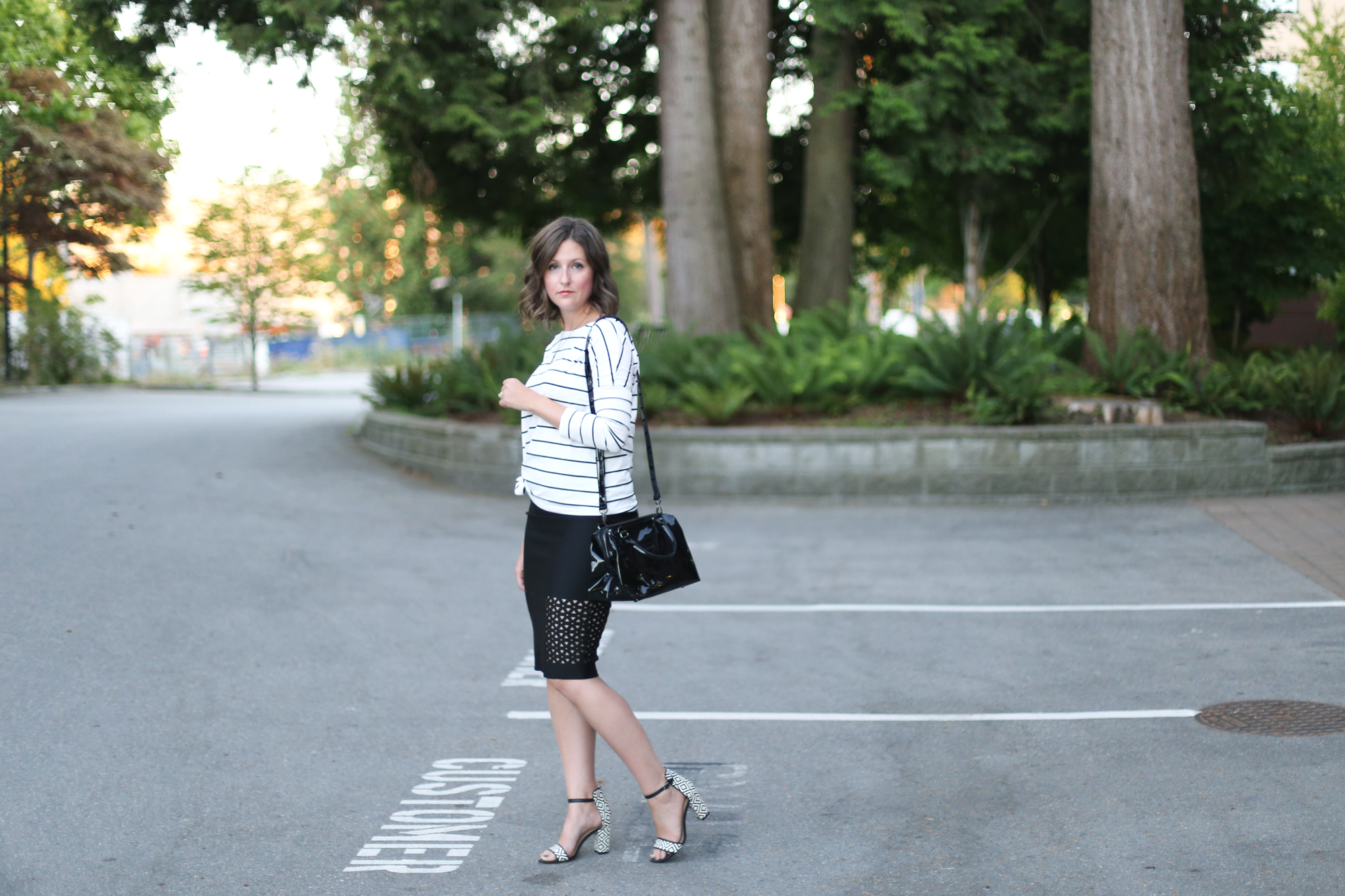 Patent Leather bag, laser cut skirt, striped shirt, lob haircut, and minimalist sandals.  #ootd