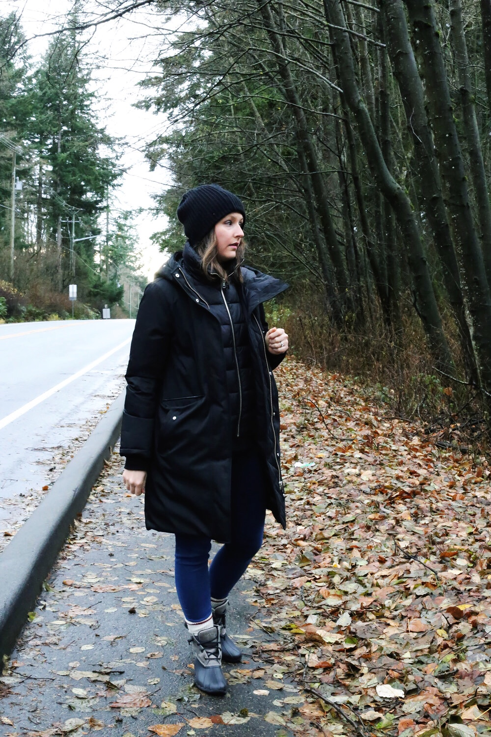 Winter street style: sio and kyo black parka, black toque, Sperry duck boots, skinny jeans, and Roots wool socks.
