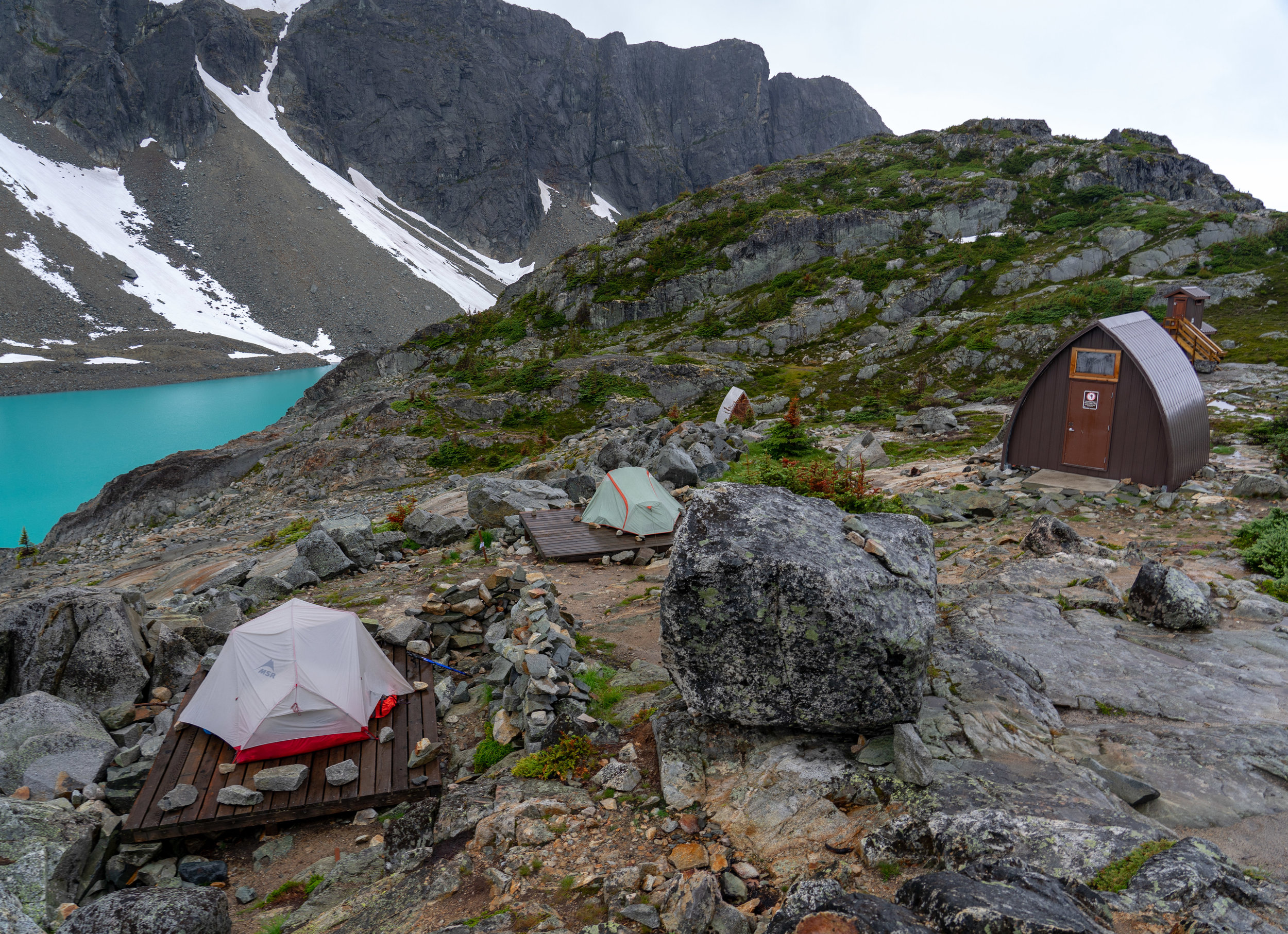 The hut and two of the tent pads at Wedgemount Lake.