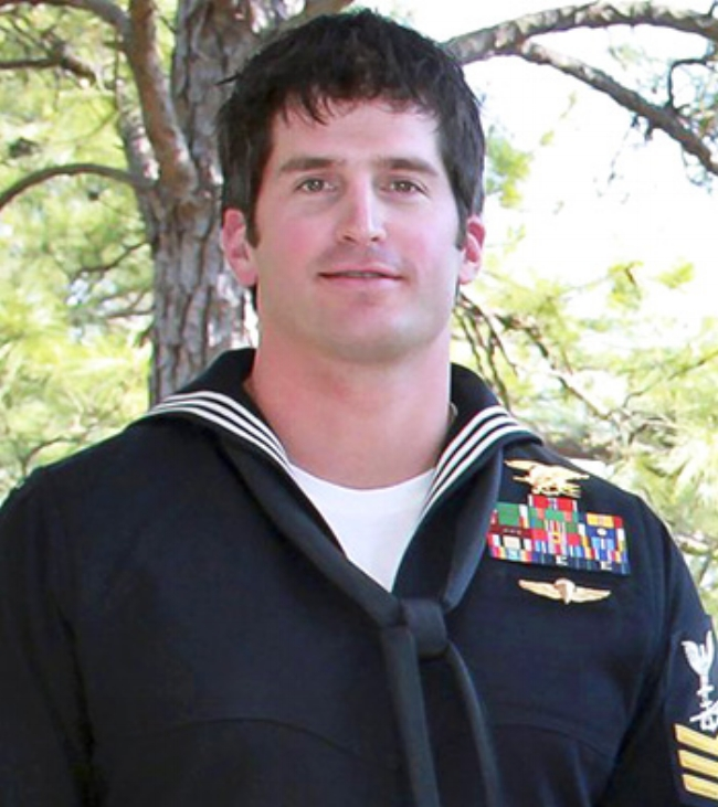 """U.S. Navy Special Warfare Operator Petty Officer 1st Class (SEAL/Enlisted Surface Warfare Specialist) Jon """"JT"""" Thomas TuMileson, 35, of Rockford, IA, assigned to an East Coast-based Naval Special Warfare unit, died on August 6, 2011, in Wardak province, Afghanistan, of wounds suffered when his helicopter crashed.  He is survived by his parents George and Kathy TuMileson, Joy and Scott McMeekan, sisters Kristie and Joy, and his dog Hawkeye.  The """"Tumilson"""" Hero WOD was first posted on crossfit.com as the workout of the day for Wednesday, July 4, 2012 (120704)."""