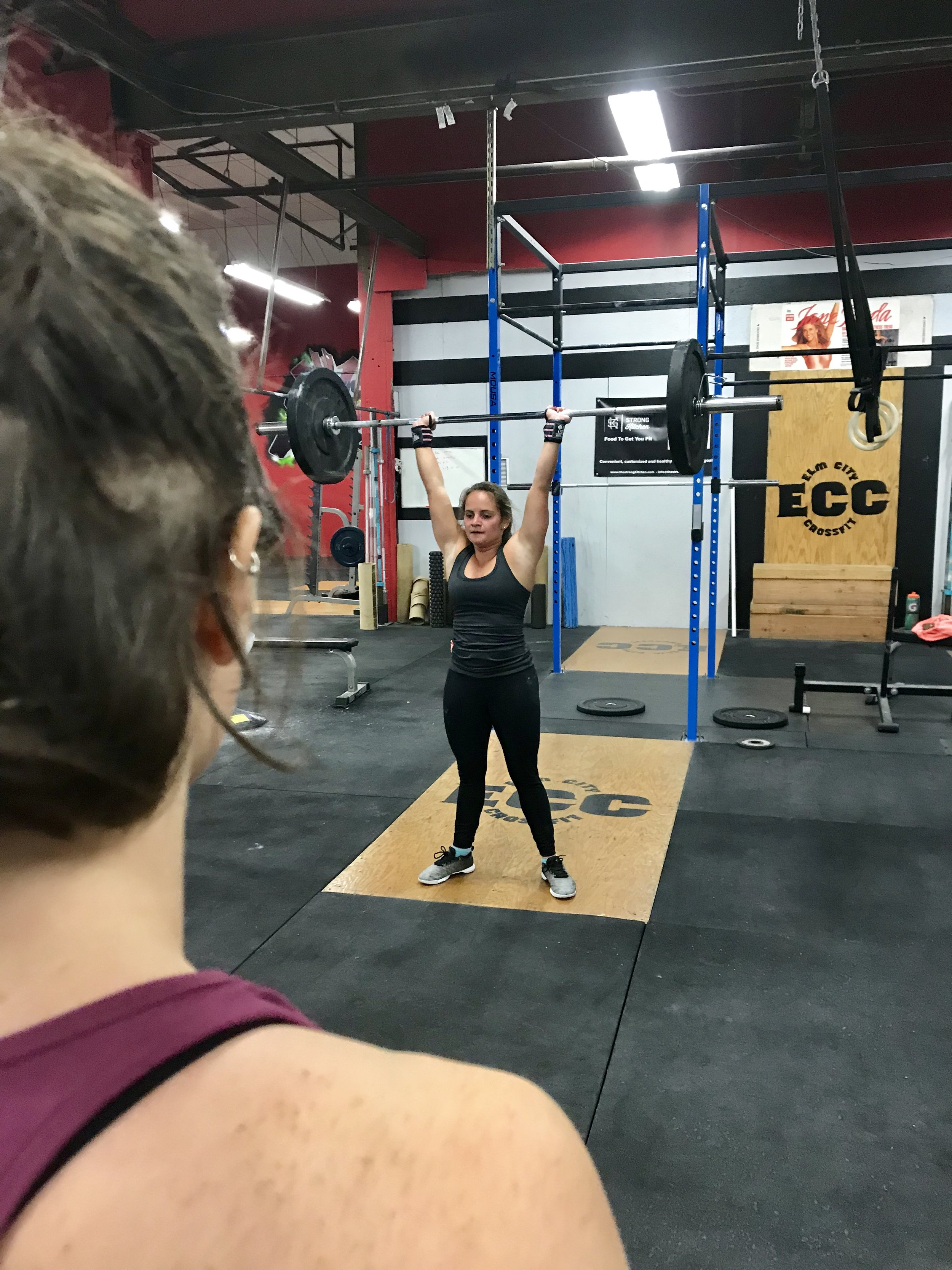 Carly looking YOKED under the watchful eye of Leslie!