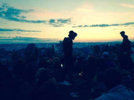 Watching the sunrise over Glastonbury 2014 from the Stone Circle.