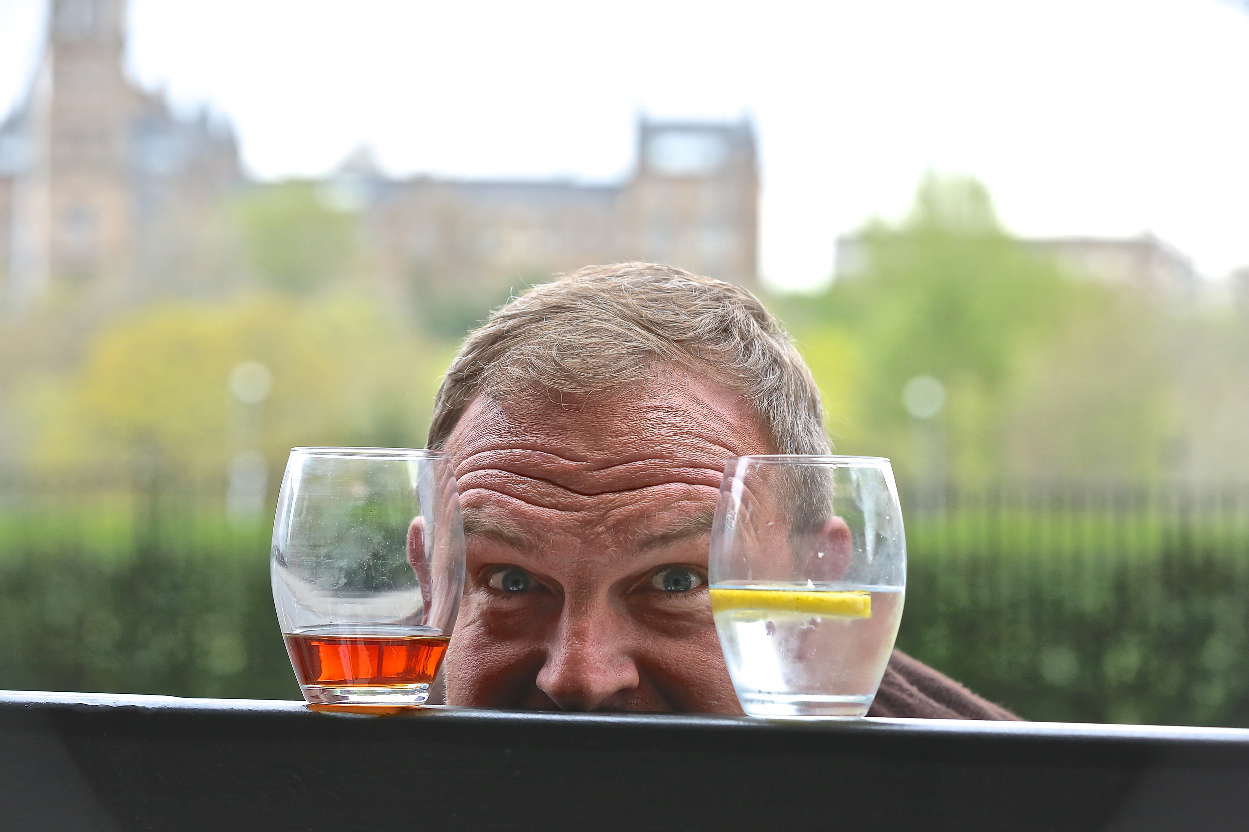 Bill Thomson with whisky and gin