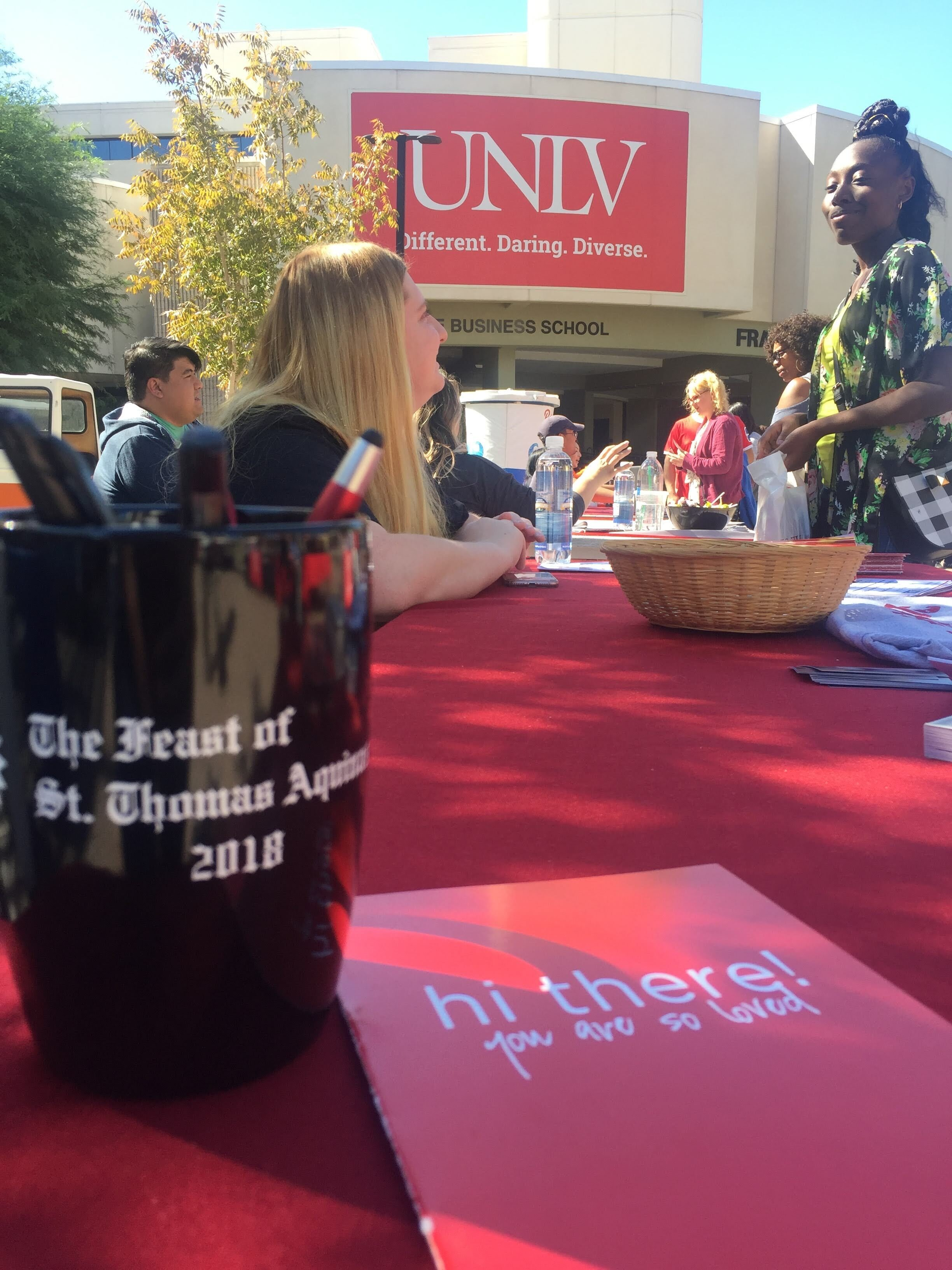 Peer Minister, Anne, welcomes UNLV students to the Newman Center during Involvement Fair
