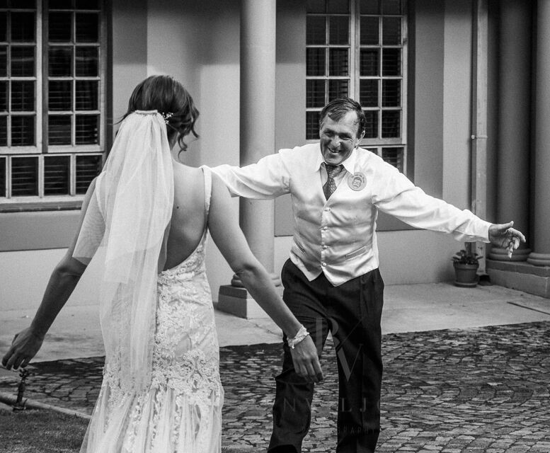 December 2017 - A joyful moment when Melanie Terblanche meets her father at Guesthouse @ 56 before travelling to the wedding venue.